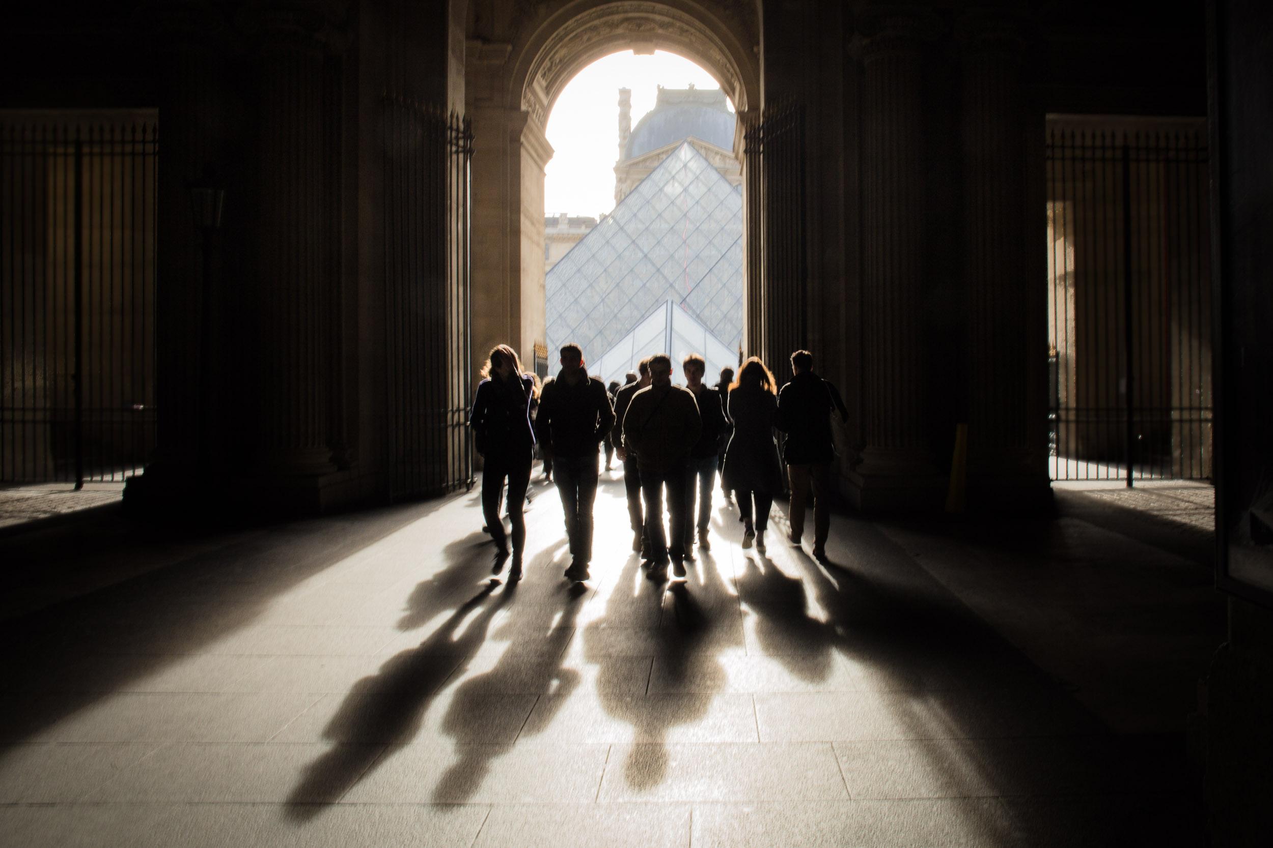 Paris-Louvre-People-Walking-in-Shadows.jpg