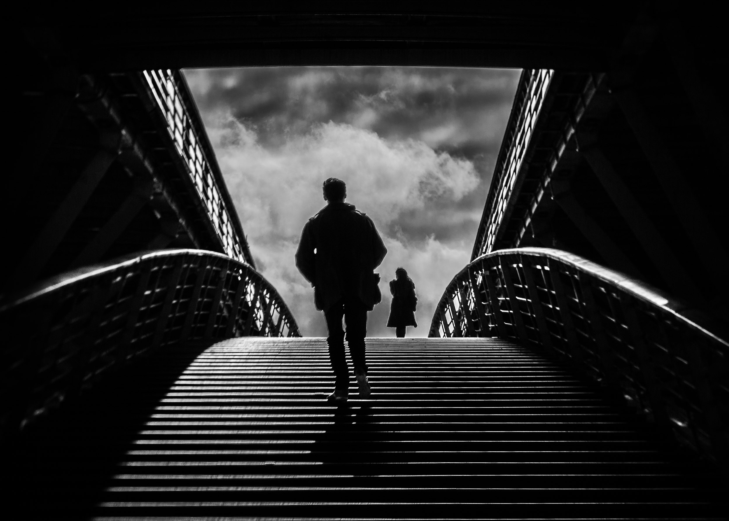 Paris-man-following-woman-on-bridge-dramatic-light.jpg