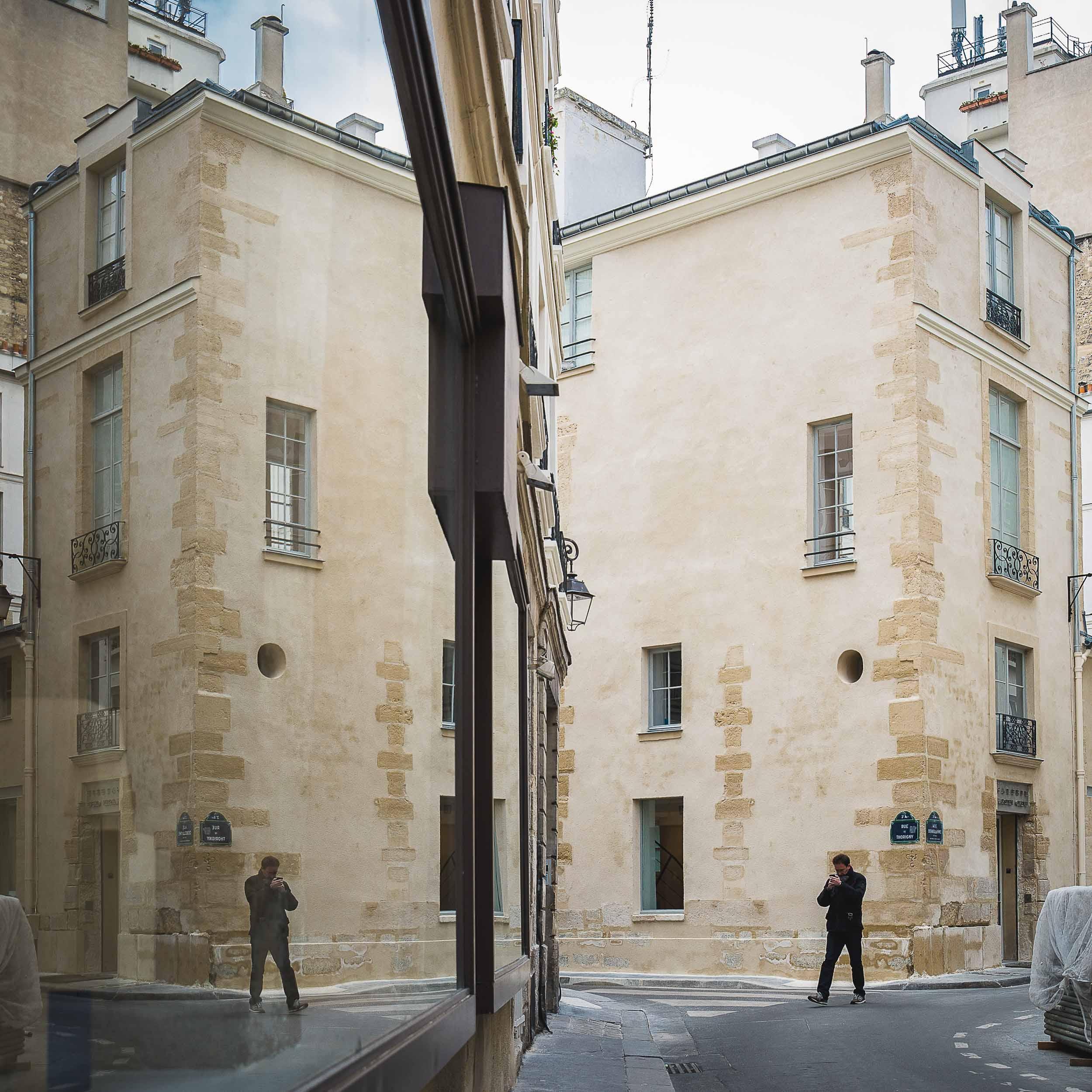 Paris-man-walking-reflection-in-window.jpg