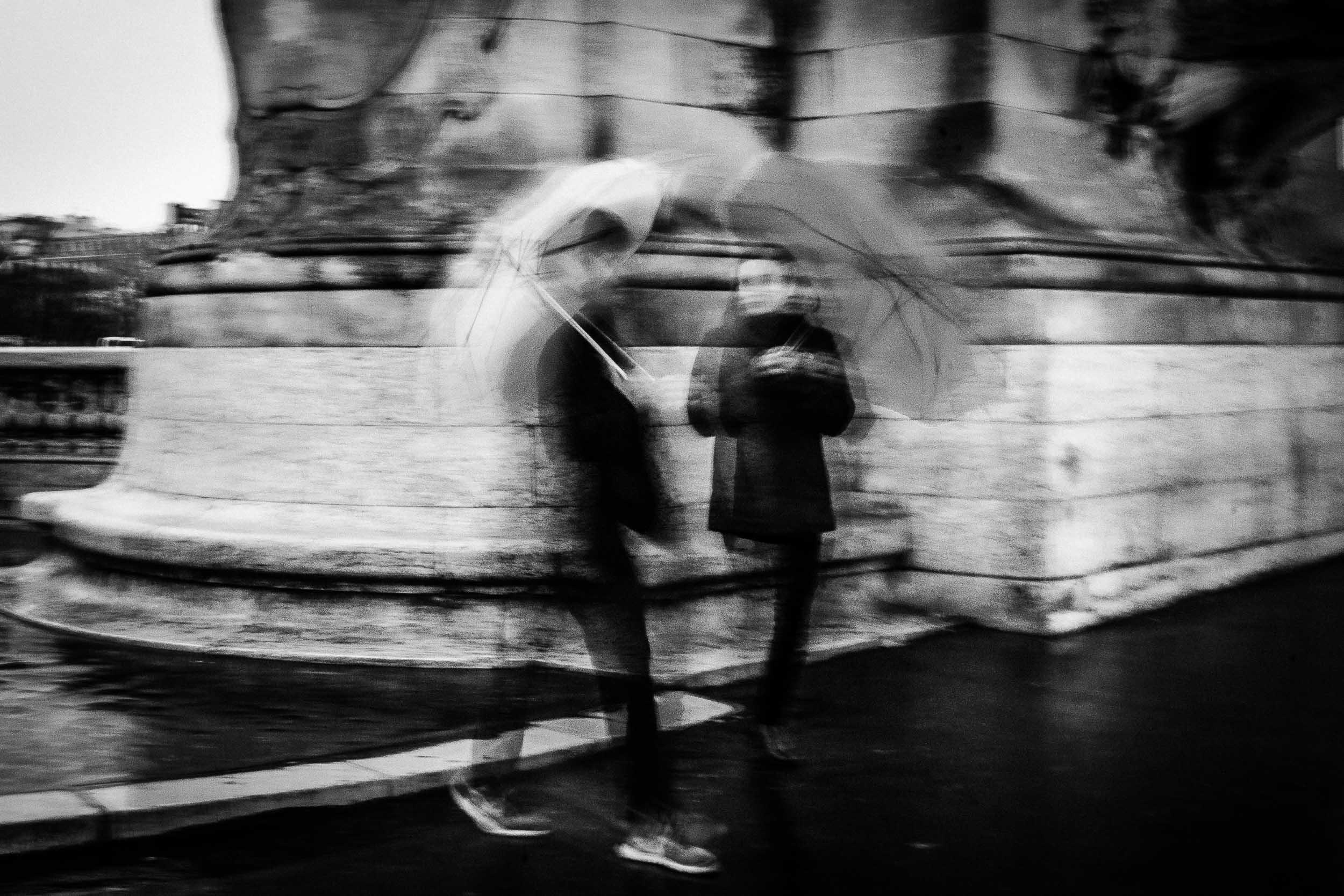 Paris-couple-walking-with-umbrellas.jpg