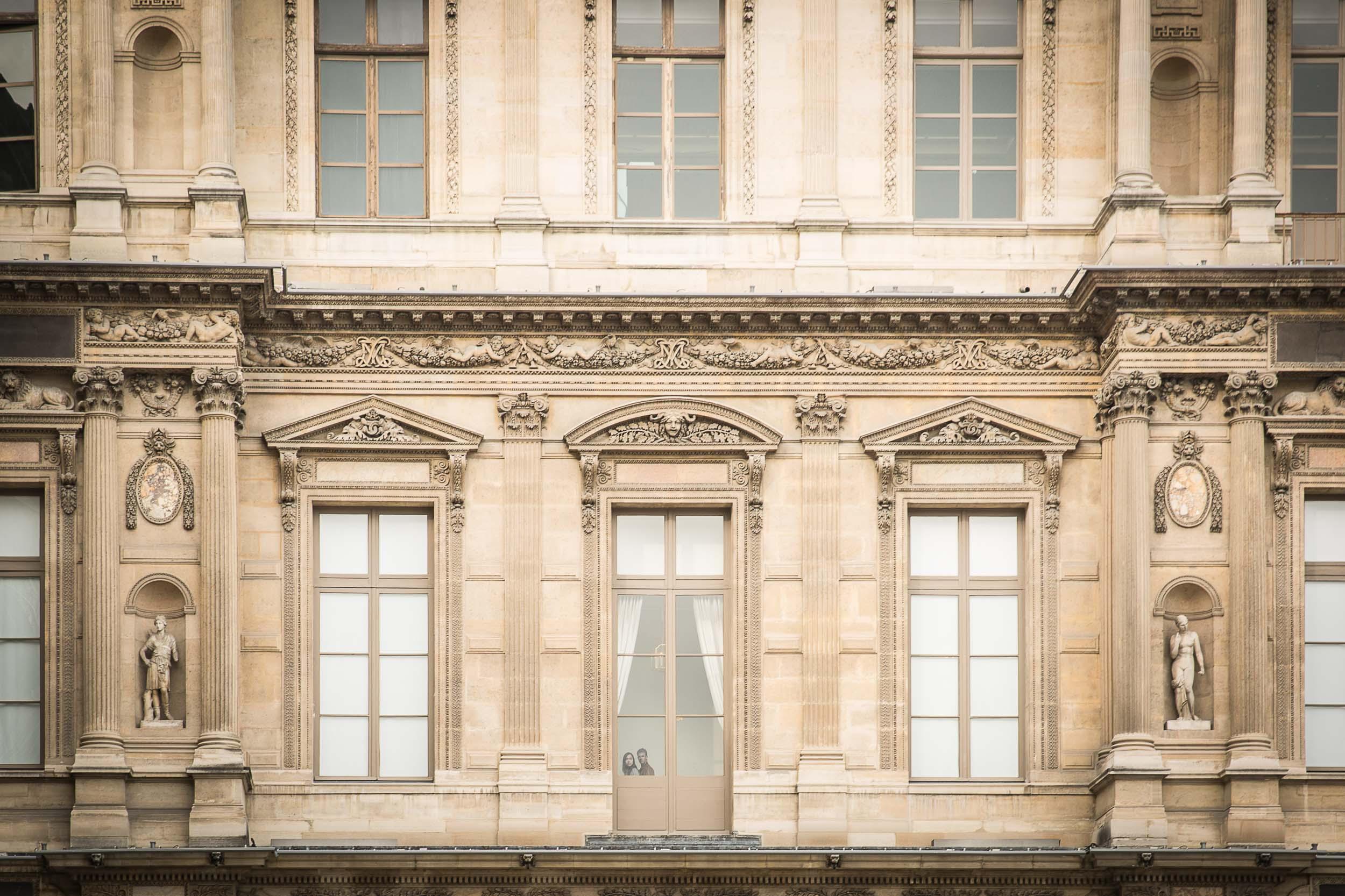 Paris-Louvre-couple-looking-from-window.jpg