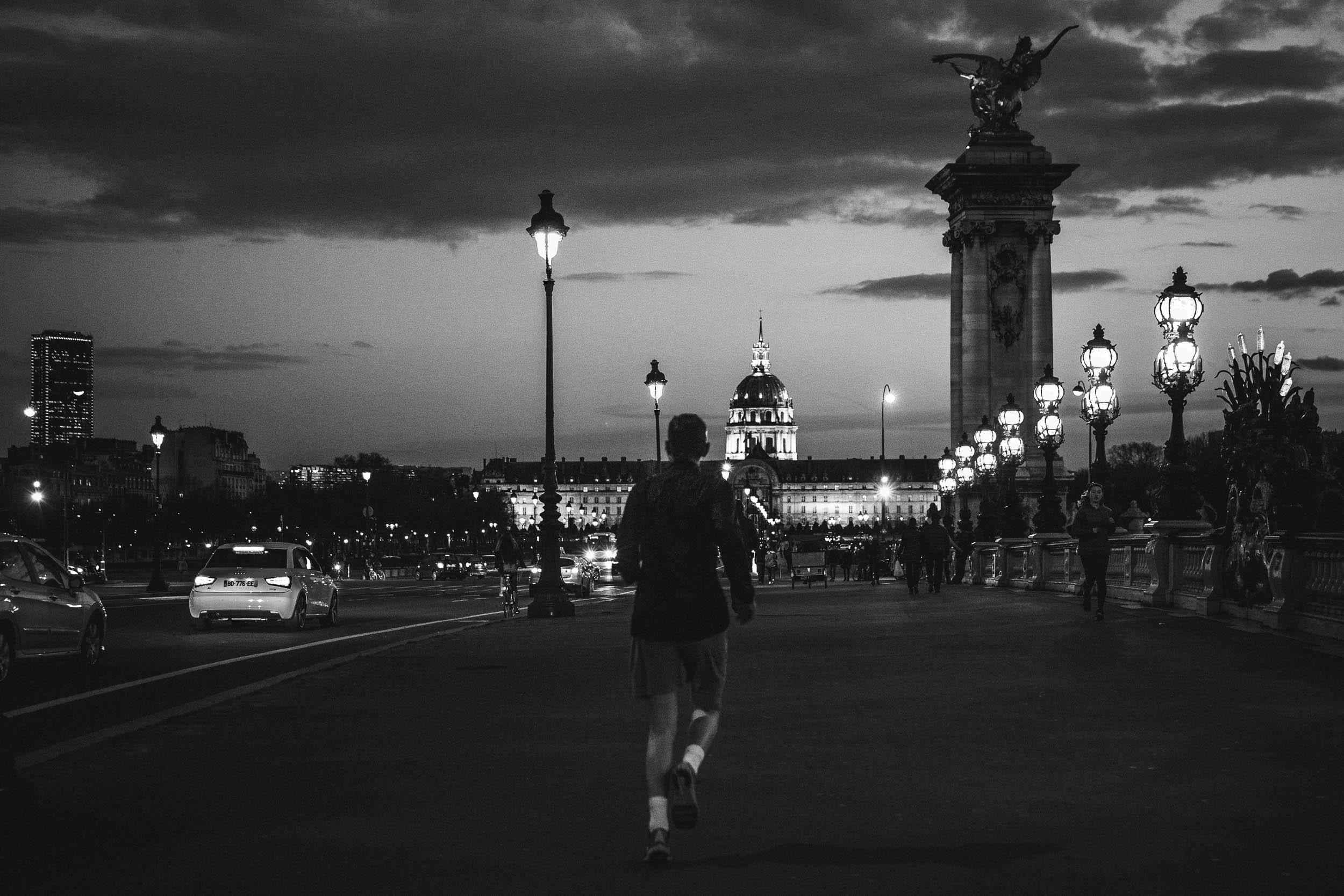 Paris-man-running-Invalides-at-night.jpg