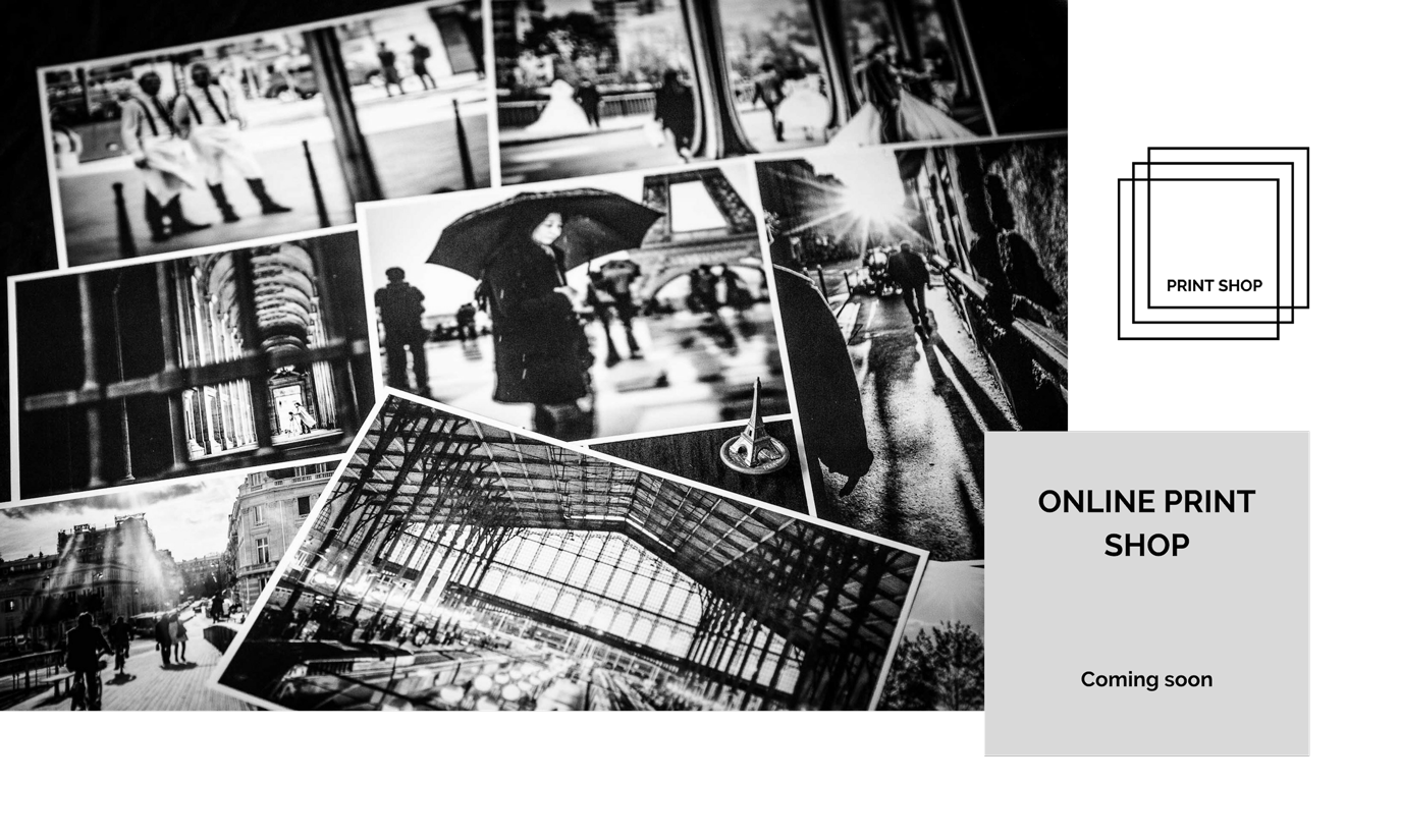 Link to online print shop. Black and white images showing Paris street photography on a table