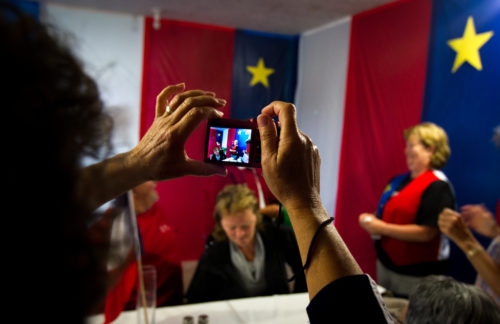Family members snap photos at a family gathering in Memramcook, NB, on the eve of National Acadian Day.