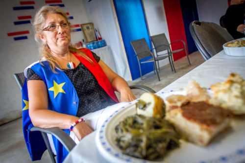 Eveline LeBlanc sits in front of a plate of rappie pie, poutine rapee, chiar, fricot, goose tongue, and pet de soeur at a traditional Acadian dinner they hold for about 30 members of extended family in their garage every August 14. Family travels from as far as British Columbia to take part in the tradition.