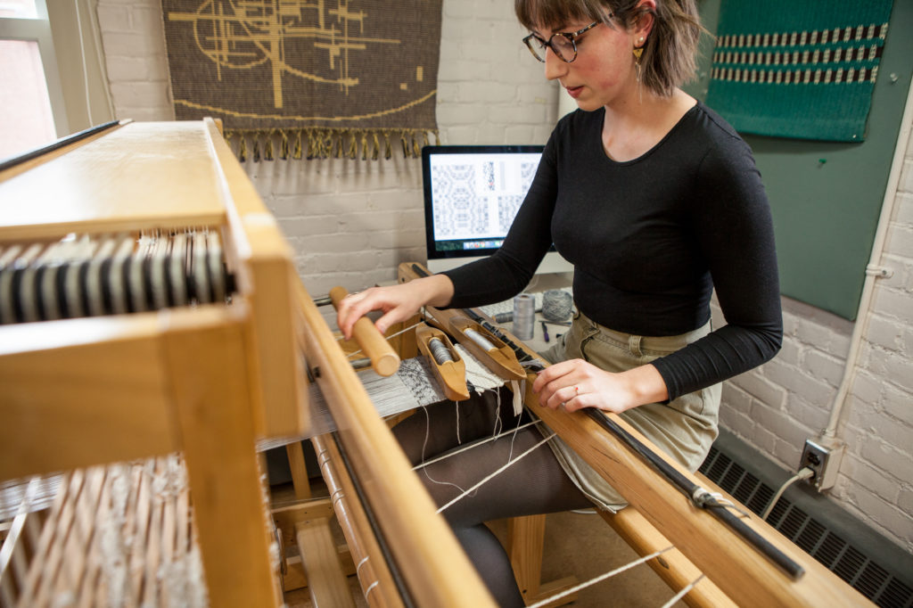 Photo by Bang On Photography - Emily Blair Weaving on CAD Loom