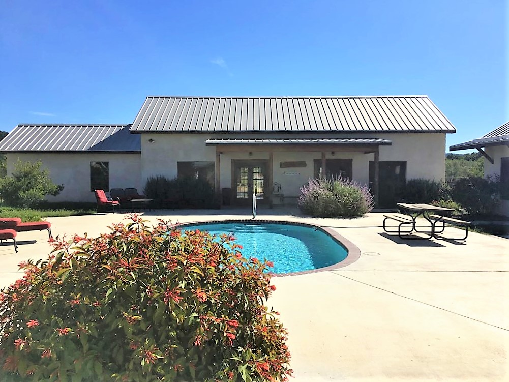 Main Bungalow and Poolside View.  Please note that Bungalow 40 is NOT located on the Frio River and river access to    Rio Bella    is NOT included .