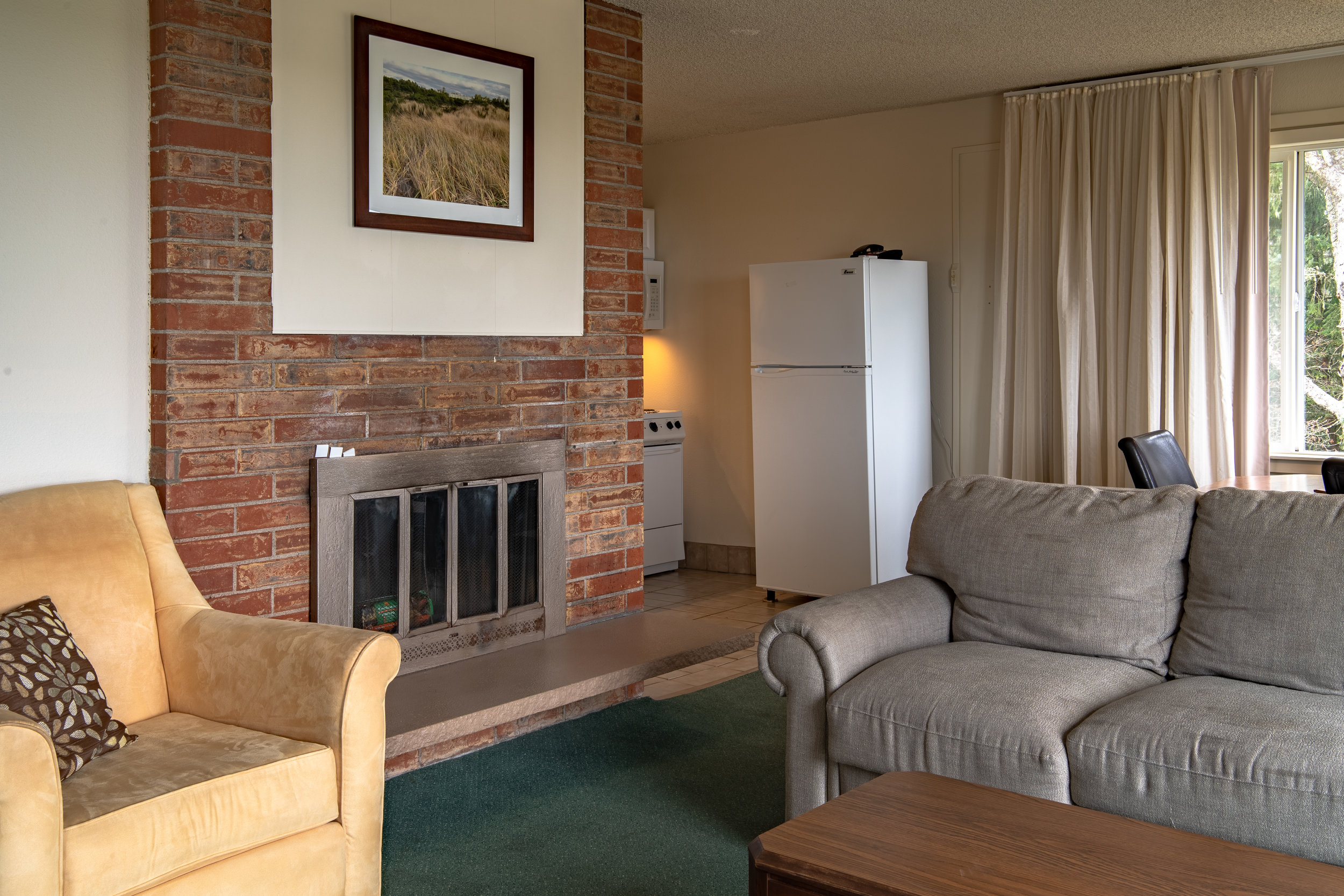 Fireplace & Kitchen - Enjoy a full kitchen, dining table, living room and fireplace.