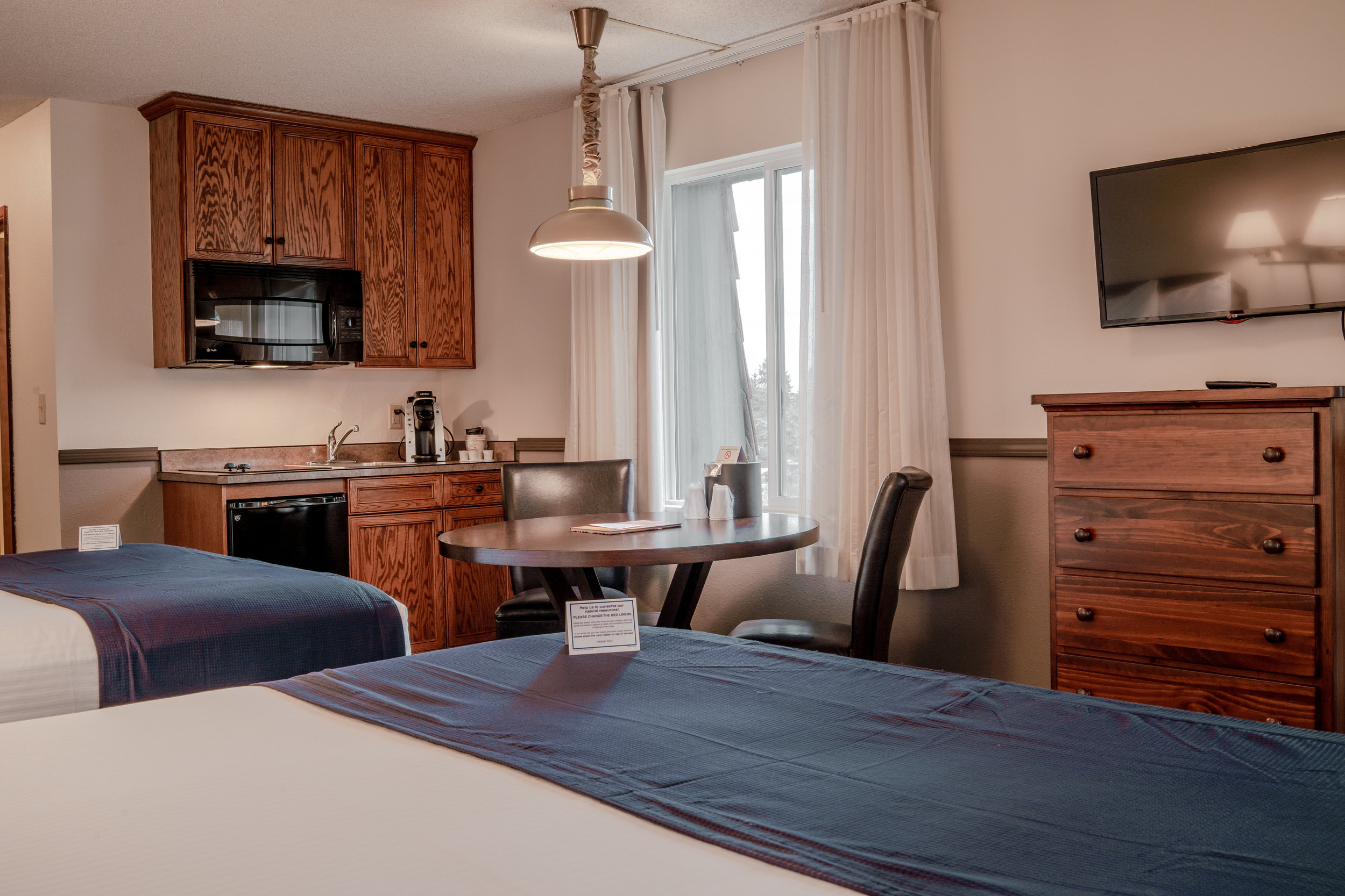 Kitchenette Rooms - Our kitchenettes rooms are fully stocked with all the cookware & utensils you will need during your stay. These rooms are equipped with a convection microwave, 2 burner stove top, mini fridge, sink and a Keurig coffee maker.