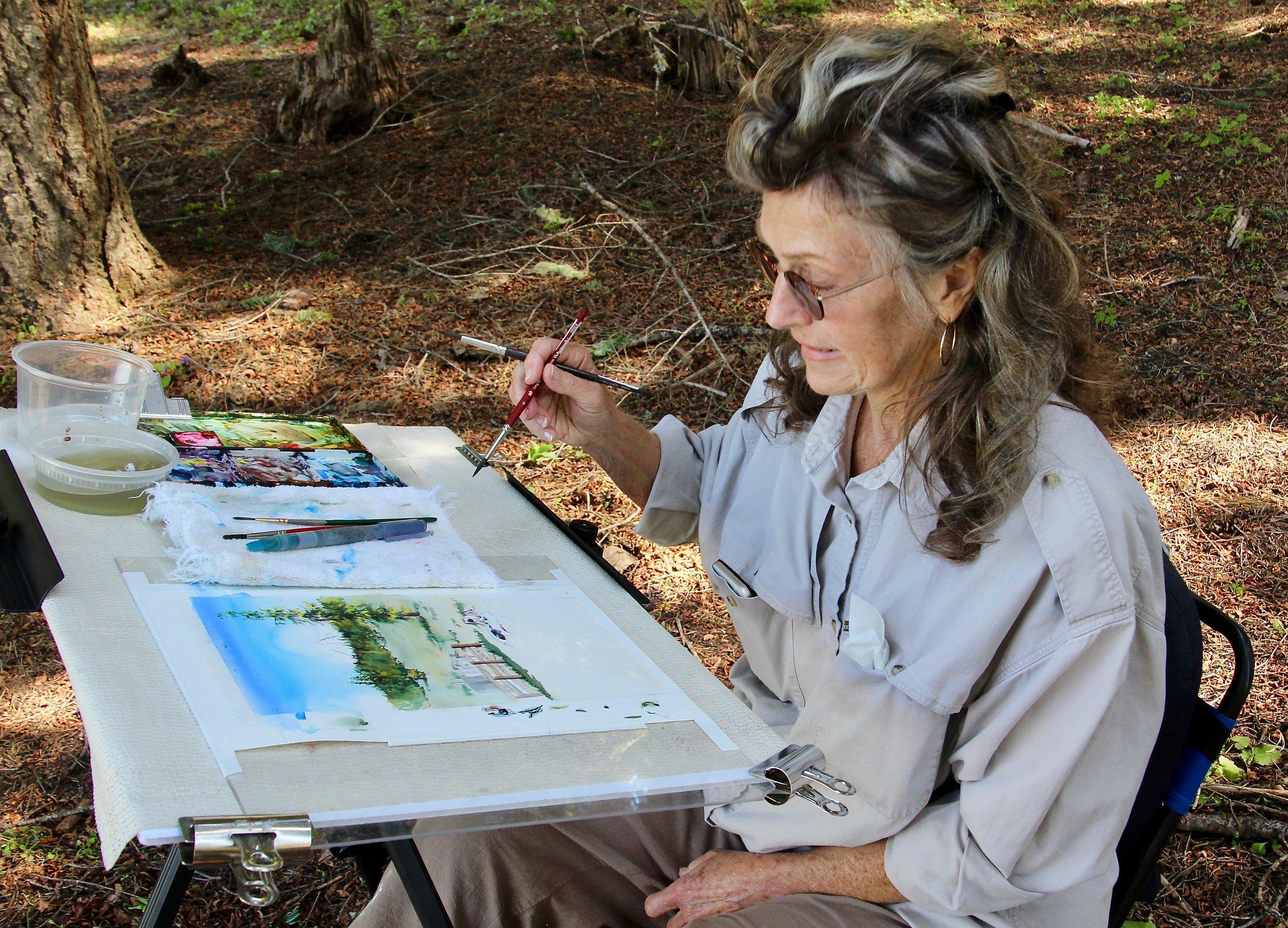 Elaine Frennett paints on-site