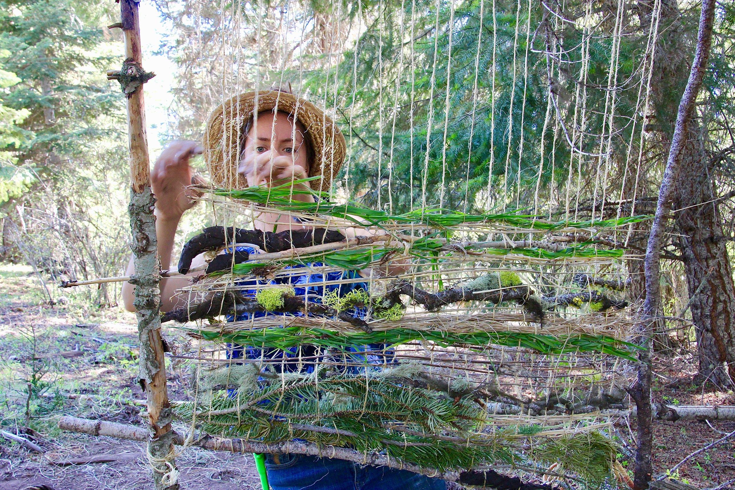 """Natural weaving mentorship at """"Artist's Day Out."""" Photo by Linda Thomas"""