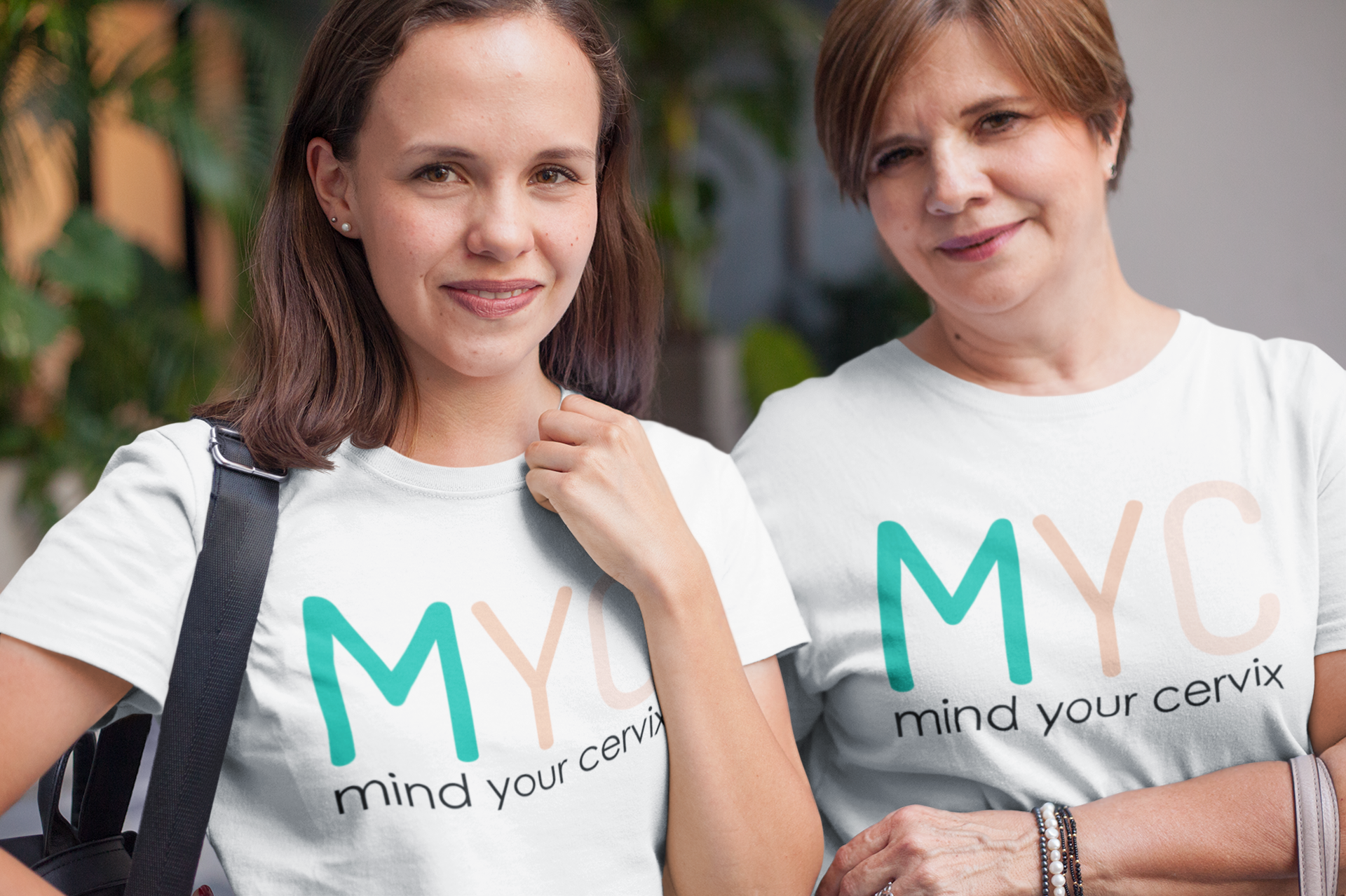 daughter-and-mom-wearing-t-shirts-mockup-taking-a-walk-downtown-a20726.png