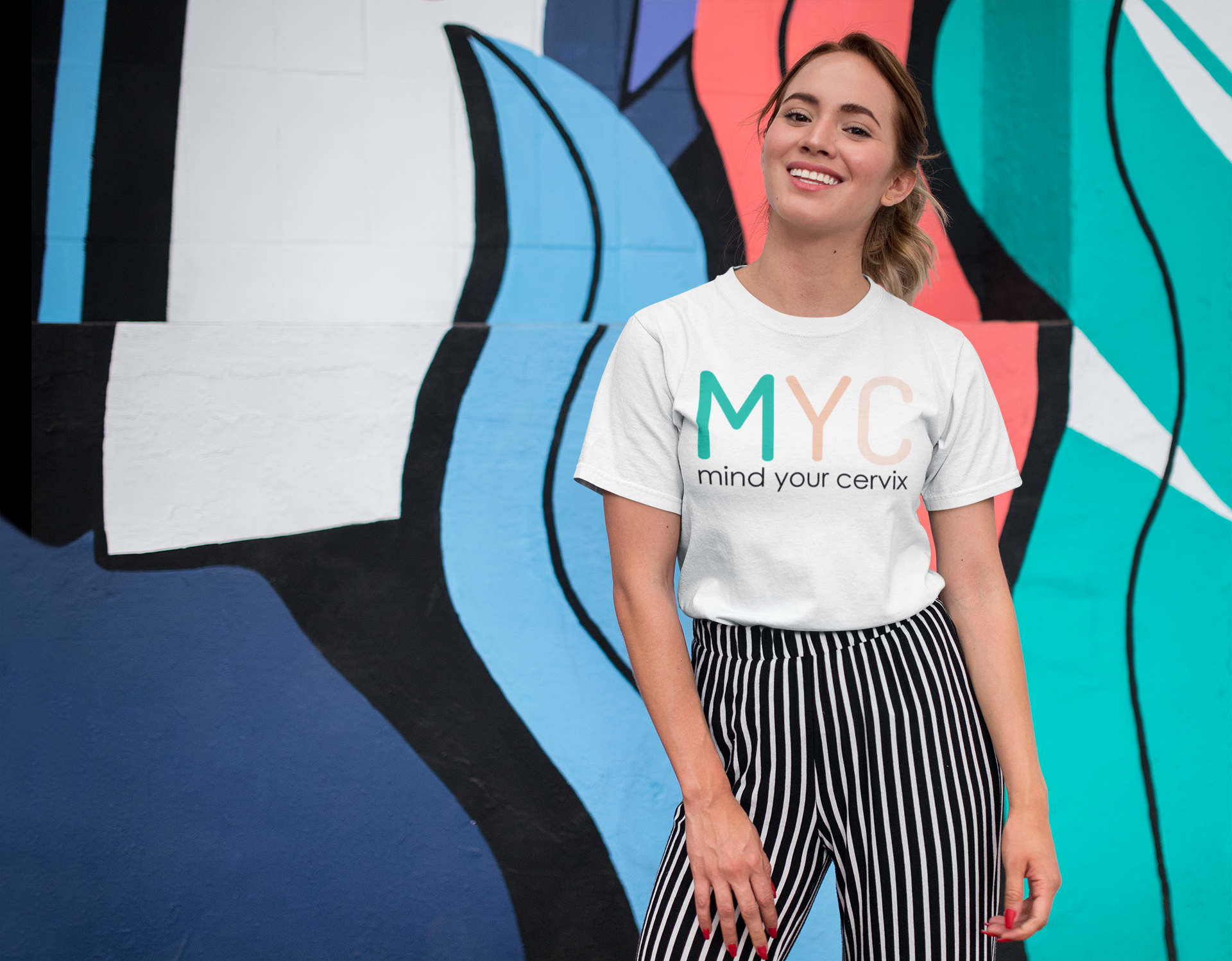 tee-mockup-of-a-smiling-girl-in-front-of-a-wall-with-colorful-illustrations-26646.png