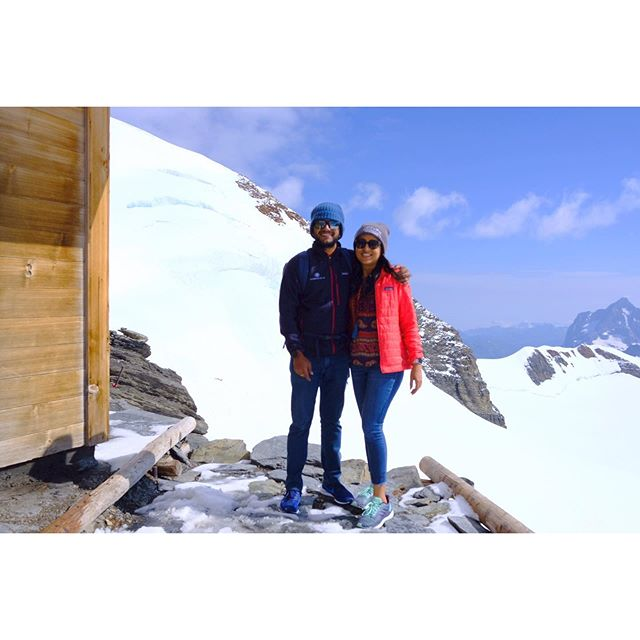 During our recent Switzerland trip, @meeraodugoudar and I hiked to Mönchsjochhütte. She is always up for any adventure! The hike was tough because we had to walk in snow, high altitude, and the sun directly on our head.  Some facts of the summit - The highest-altitude serviced hut in Switzerland is accessible from the Jungfraujoch on a marked footpath in 45 minutes. The photo is by the Hut. - The trail to get here leads through the alpine glacier world in the midst of the UNESCO World Natural Heritage Swiss Alps Jungfrau-Aletsch. - The hut offers a breathtaking view into Central and Eastern Switzerland as well as the Valais mountains - No less impressive is daily life at 3,650 metres above sea level. Even the most mundane tasks need a special solution here. You wash with melt water from a 3000-litre tank; the hut keeper gets food and drinks from the Jungfraujoch on a snowmobile.  Apparently, Staying overnight in a dormitory is open to everyone. Sunset and sunrise included. Where else can you find this?  #wanderlust #travel #topofeurope #uniqueplaces #alps #highaltitude #europe