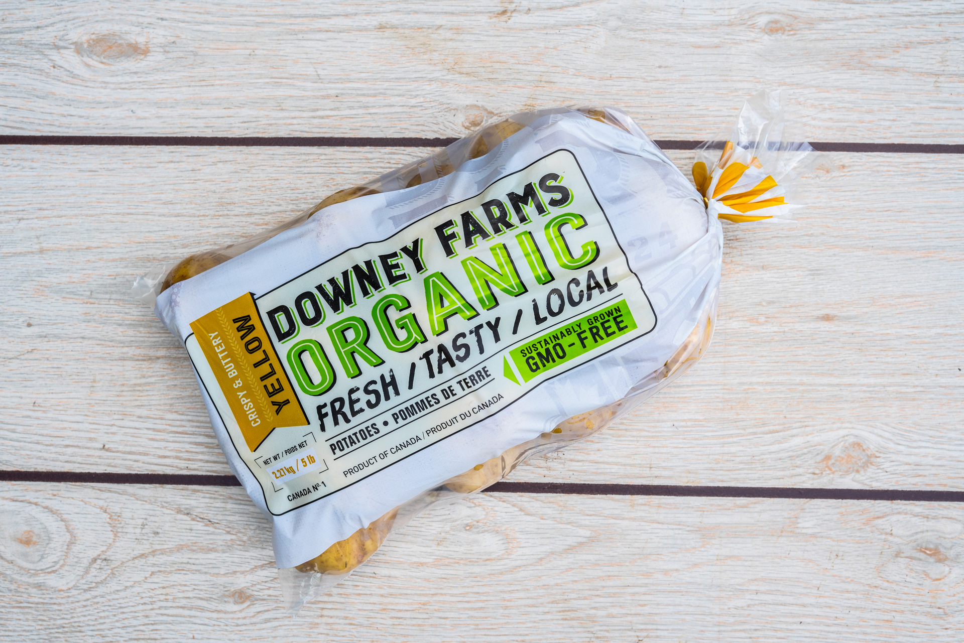 Downey Farms Organic Yellow Potatoes package design. GMO free potatoes.