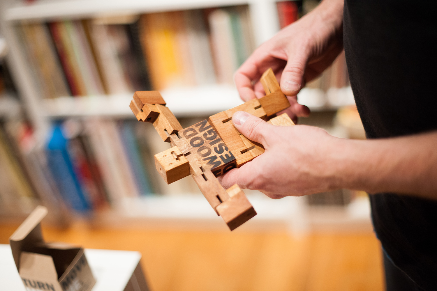 Touchwood Design silkscreened each block by hand to create a unique wooden robot for their clients.