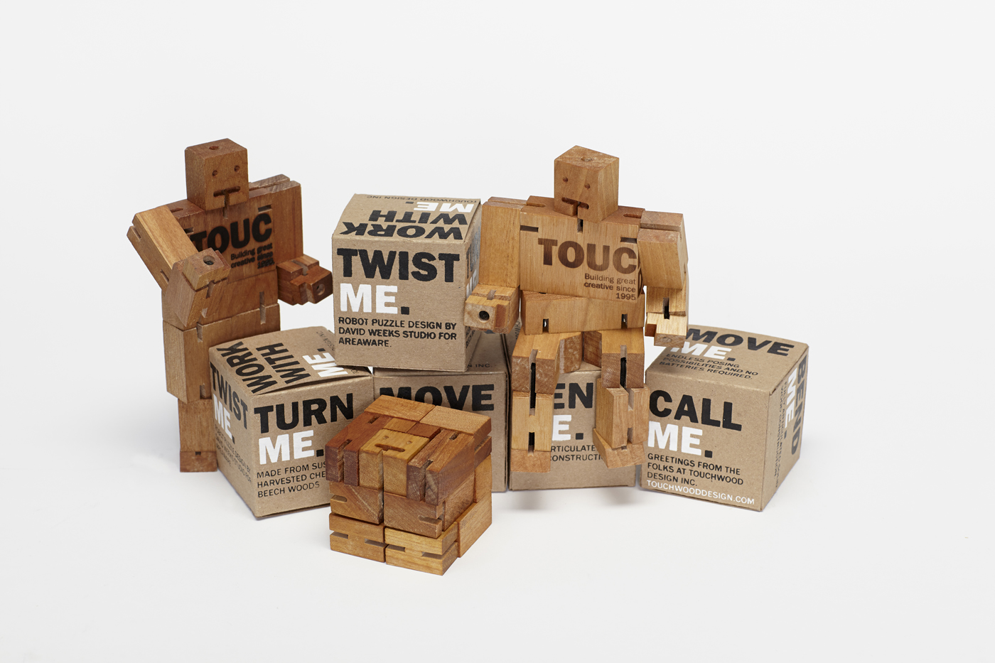 Packaging for the wooden robot. Silk screened brown boxes and a wooden puzzle that transforms into a robot.