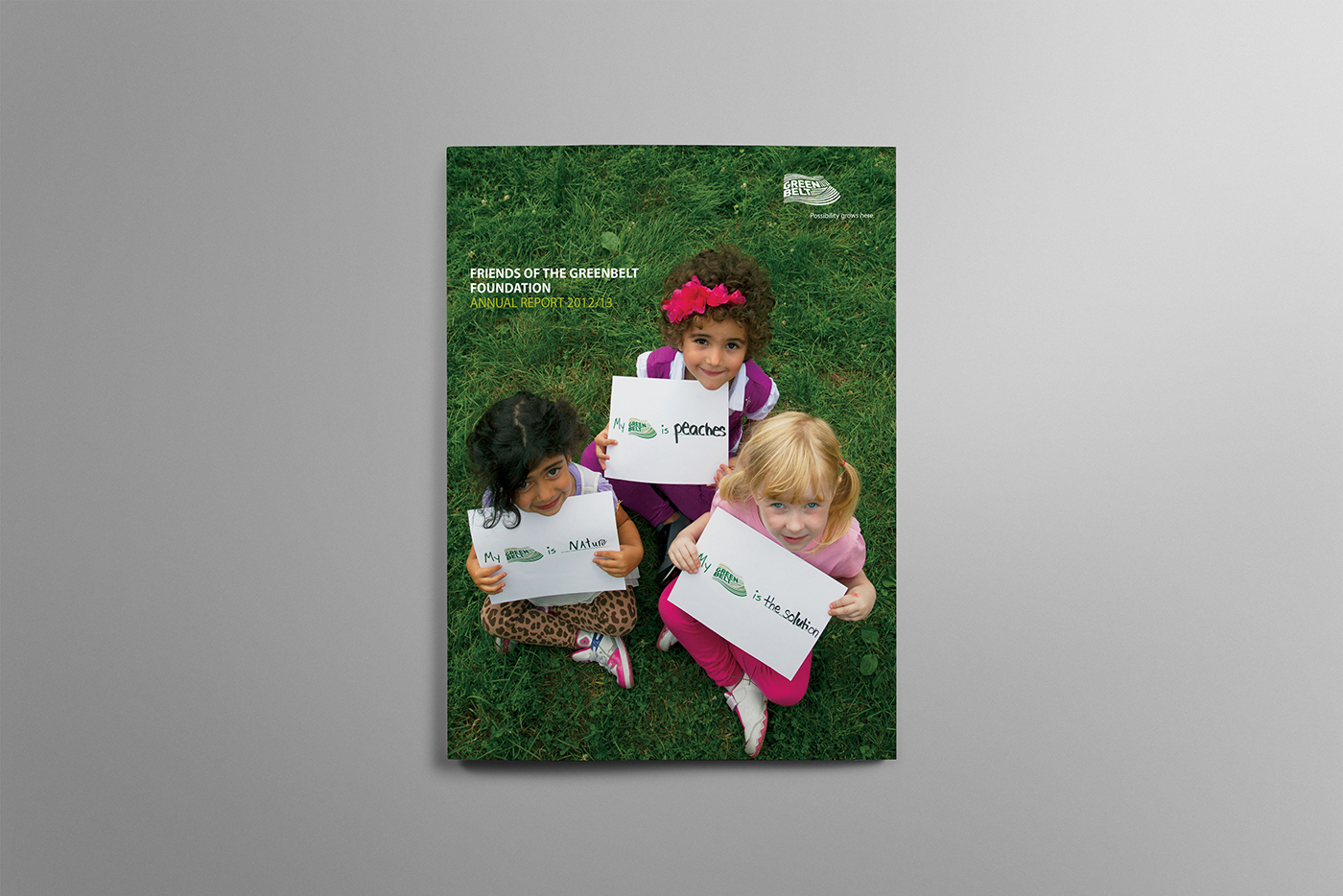 Cover for the 2012/2013 Greenbelt Foundation annual report featuring little girls speaking out about how the greenbelt is important to them.