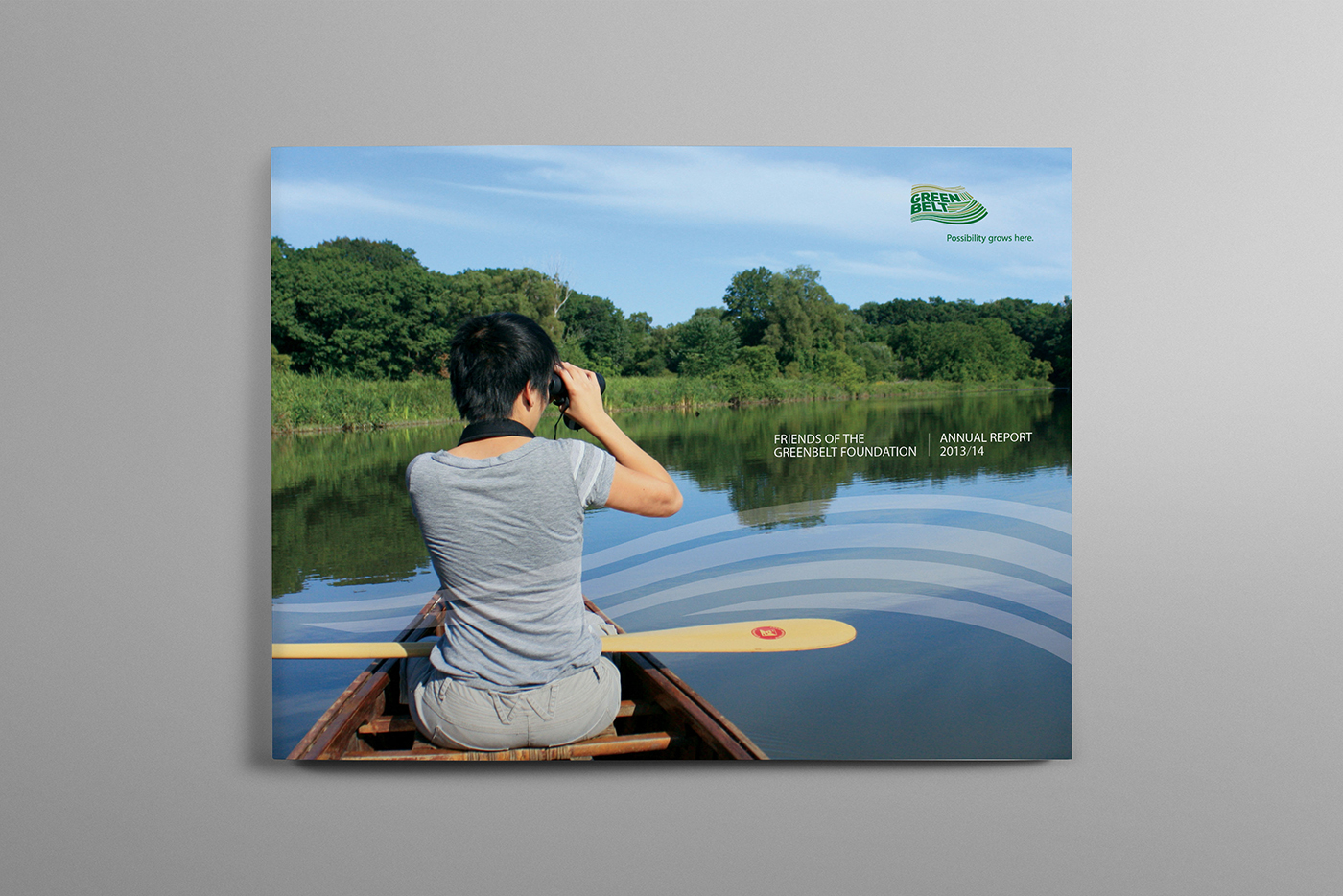 Woman canoeing and taking photos in lake in Canada's Greenbelt.