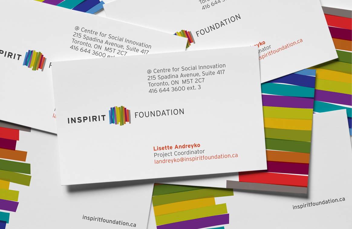 Collateral design for Inspirit Foundation includes business cards. Bright but corporate design.