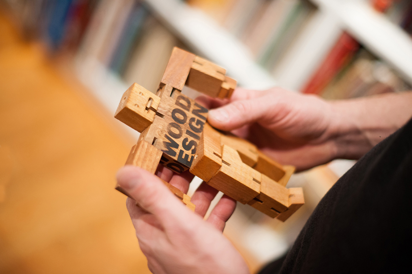 Cube of wood that transforms as you twist the puzzle.
