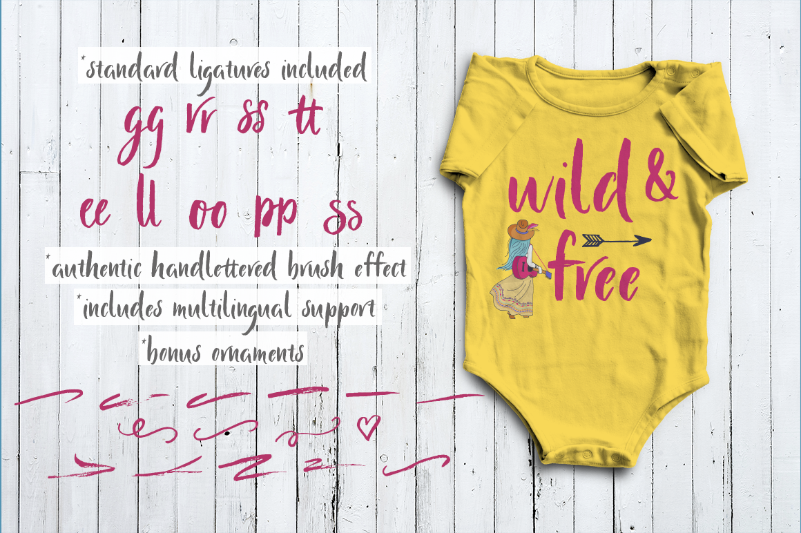 yellow baby onesie with font displayed as wild and free.