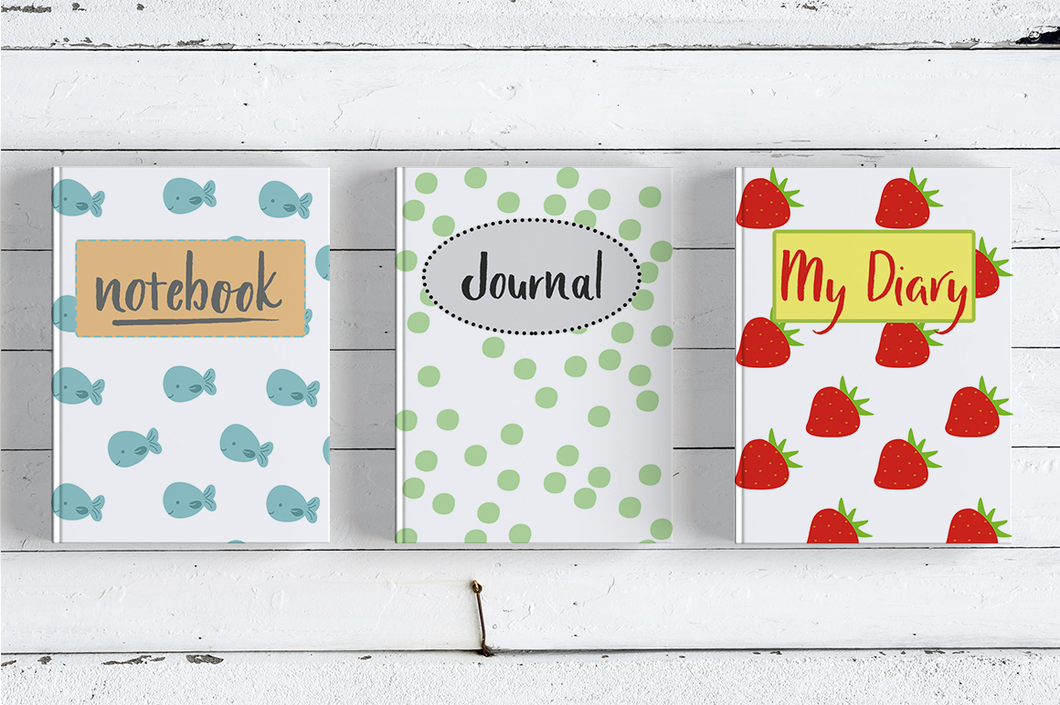 three colorful journals with the hand lettered font used on the front covers.