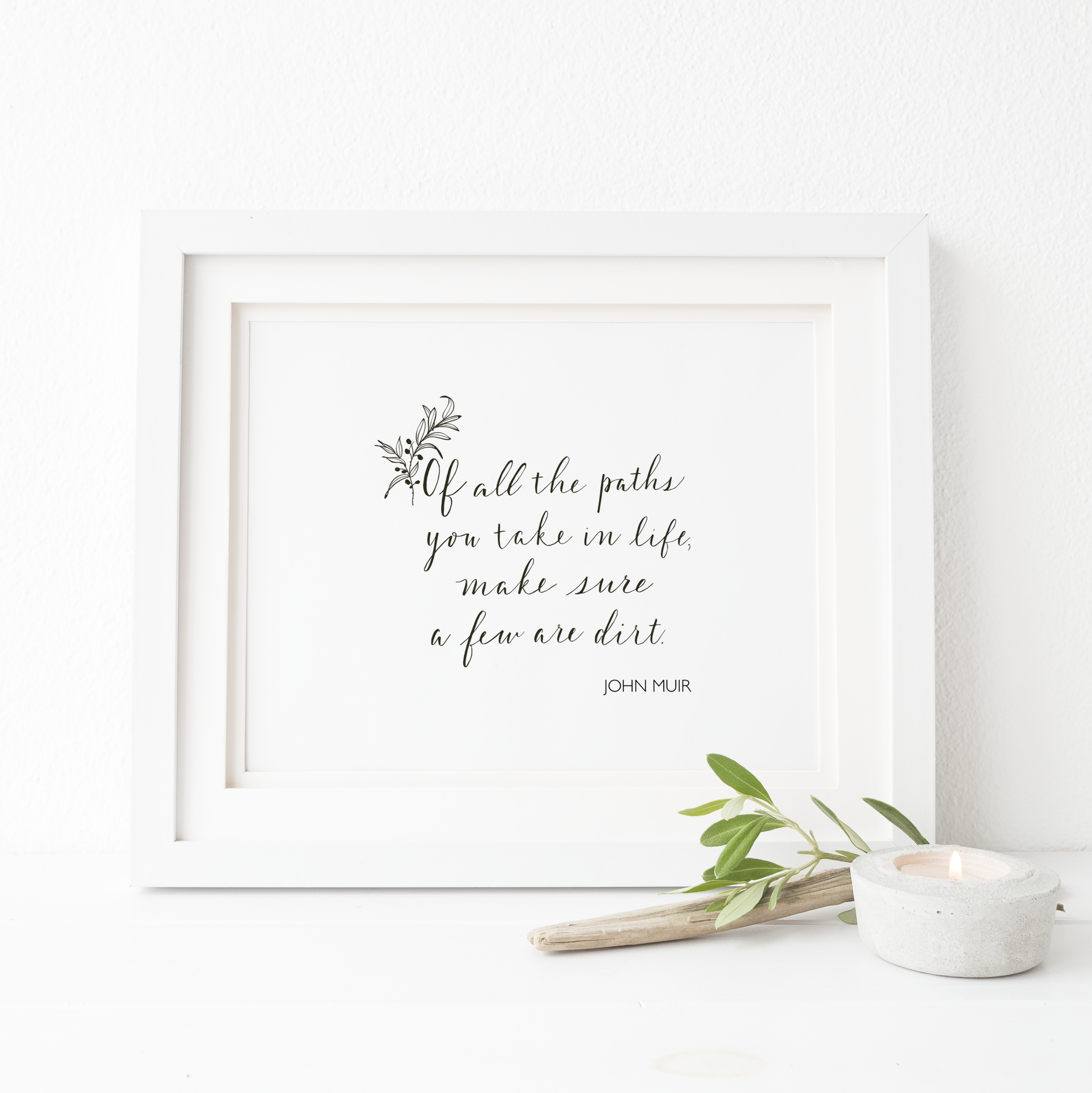 White framed print of John Muir quote, of all the paths...make sure a few are dirt.