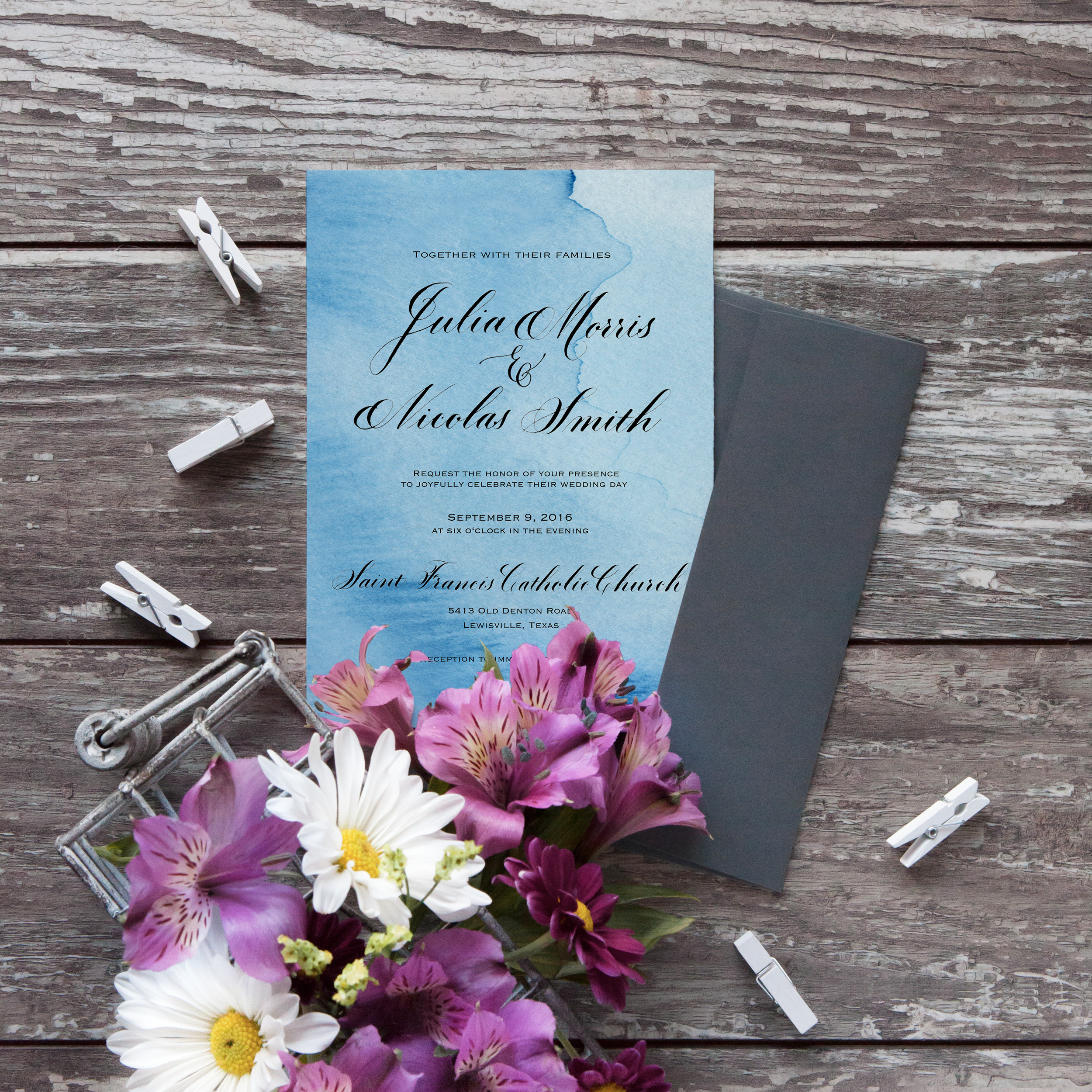 Wedding invitations with blue watercolor and black calligraphy.