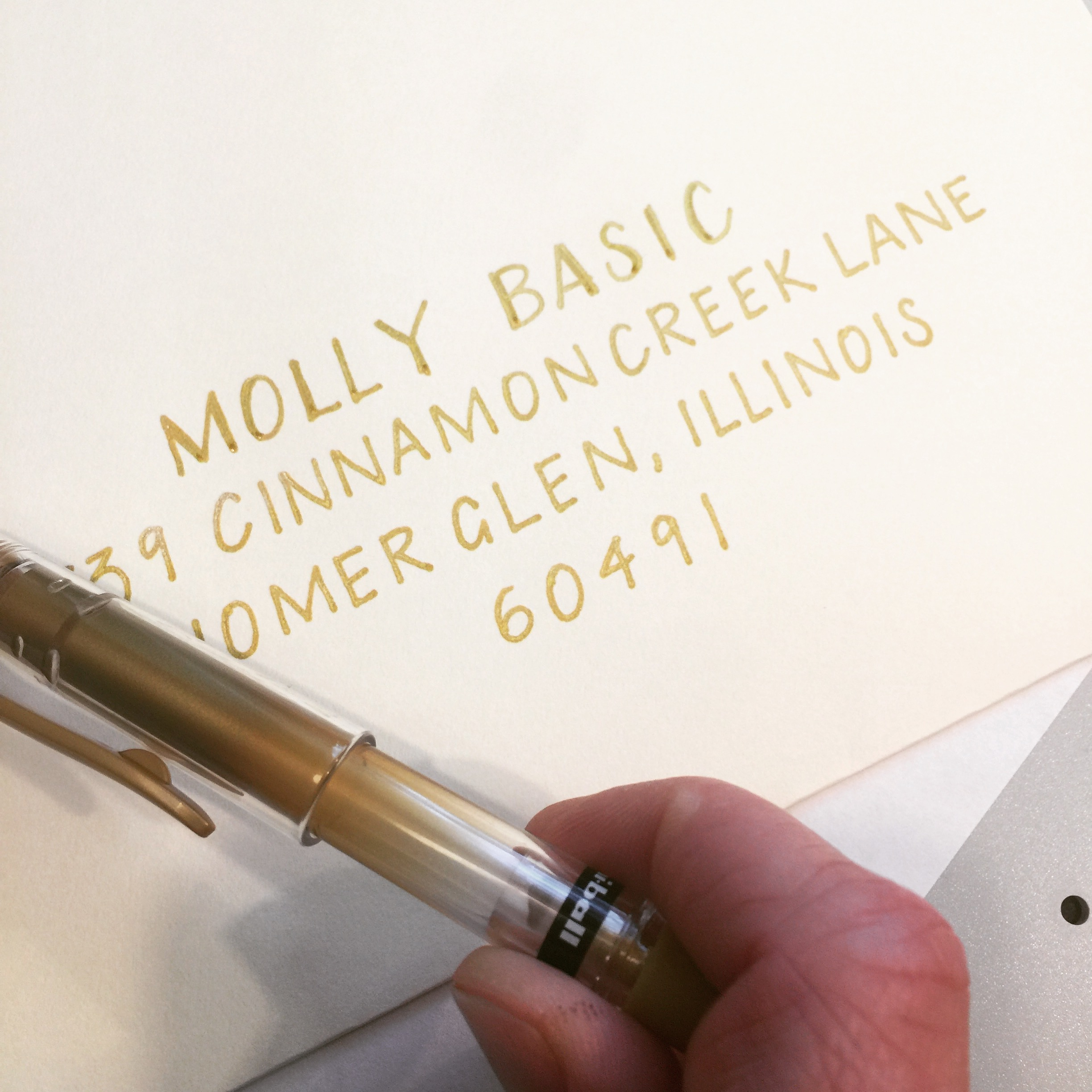 gold block lettering envelope address