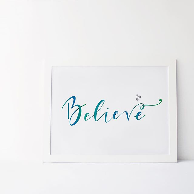 watercolor believe print in white frame