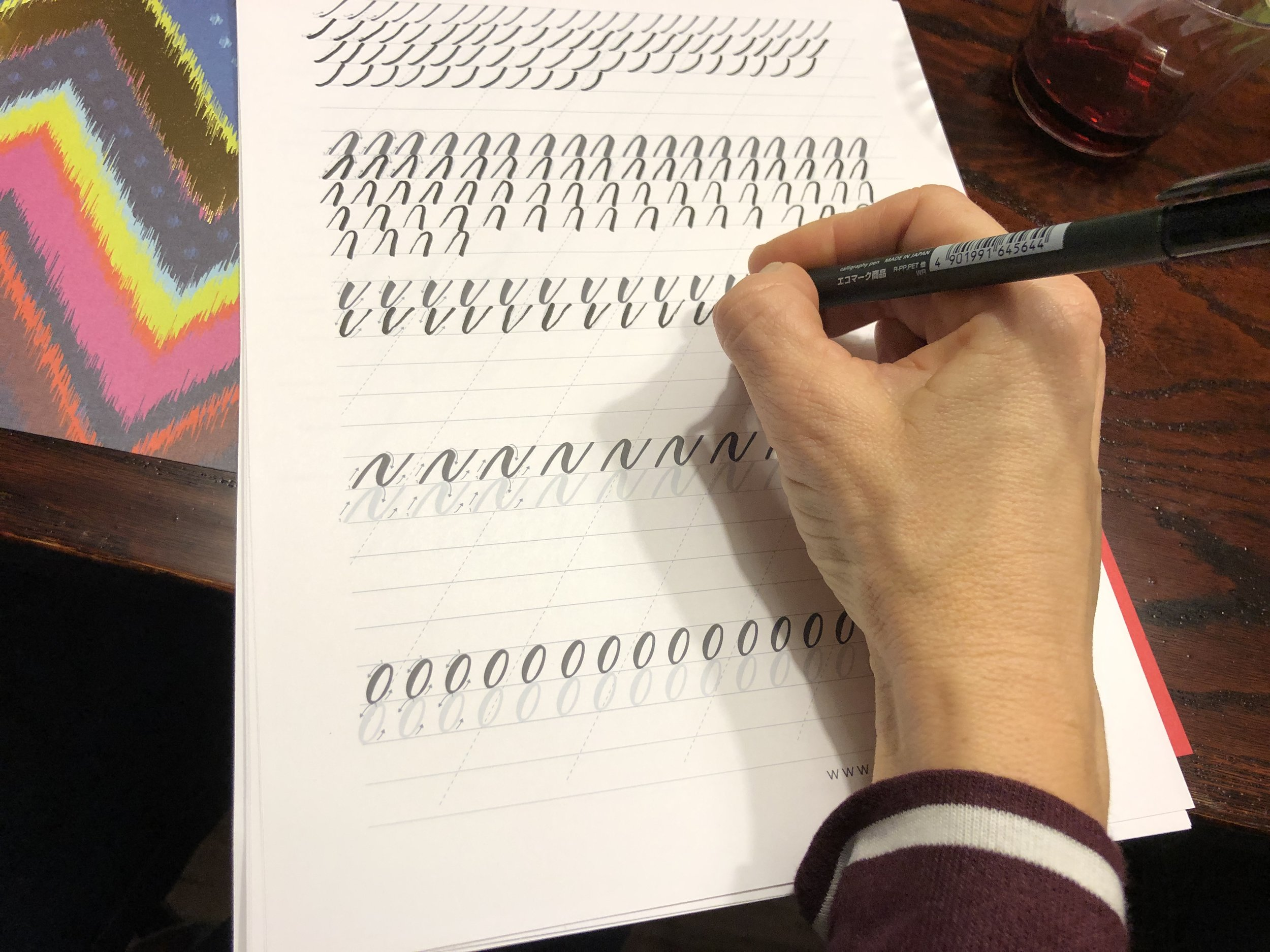 person practicing their basic lettering shapes