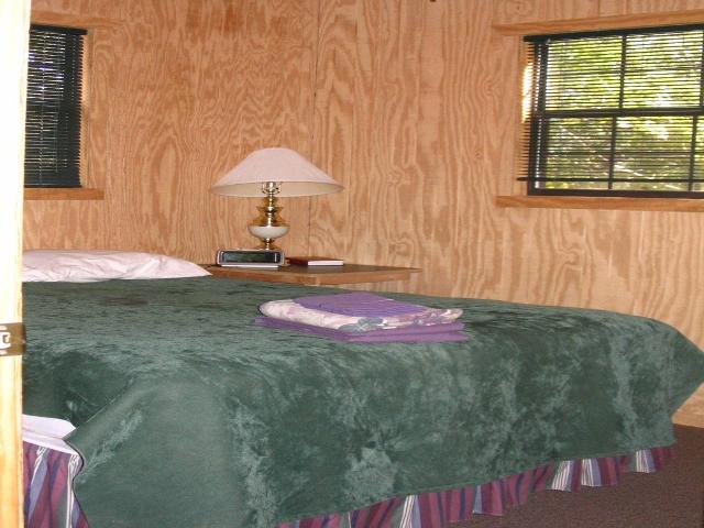 Tour-12-Deluxe Cabin Queen Bedroom.jpg