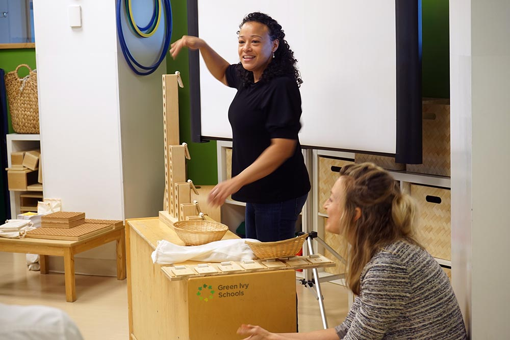 Michelle Dion demonstrates the Binary Towers; image: Courtney Lailey, Battery Park Montessori and Green Ivy Schools
