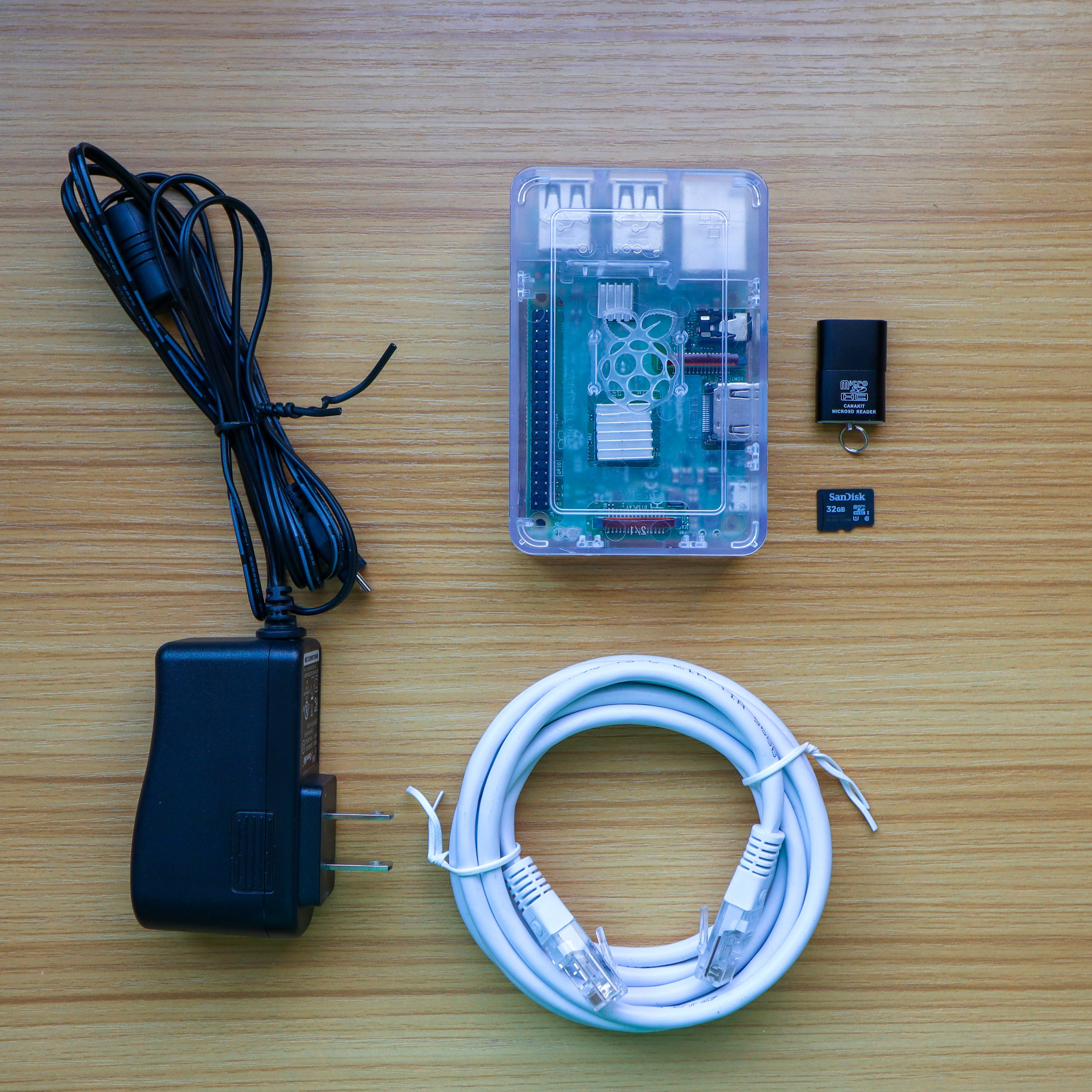 Raspberry pi, power supply, ethernet cable, and micro-sd card