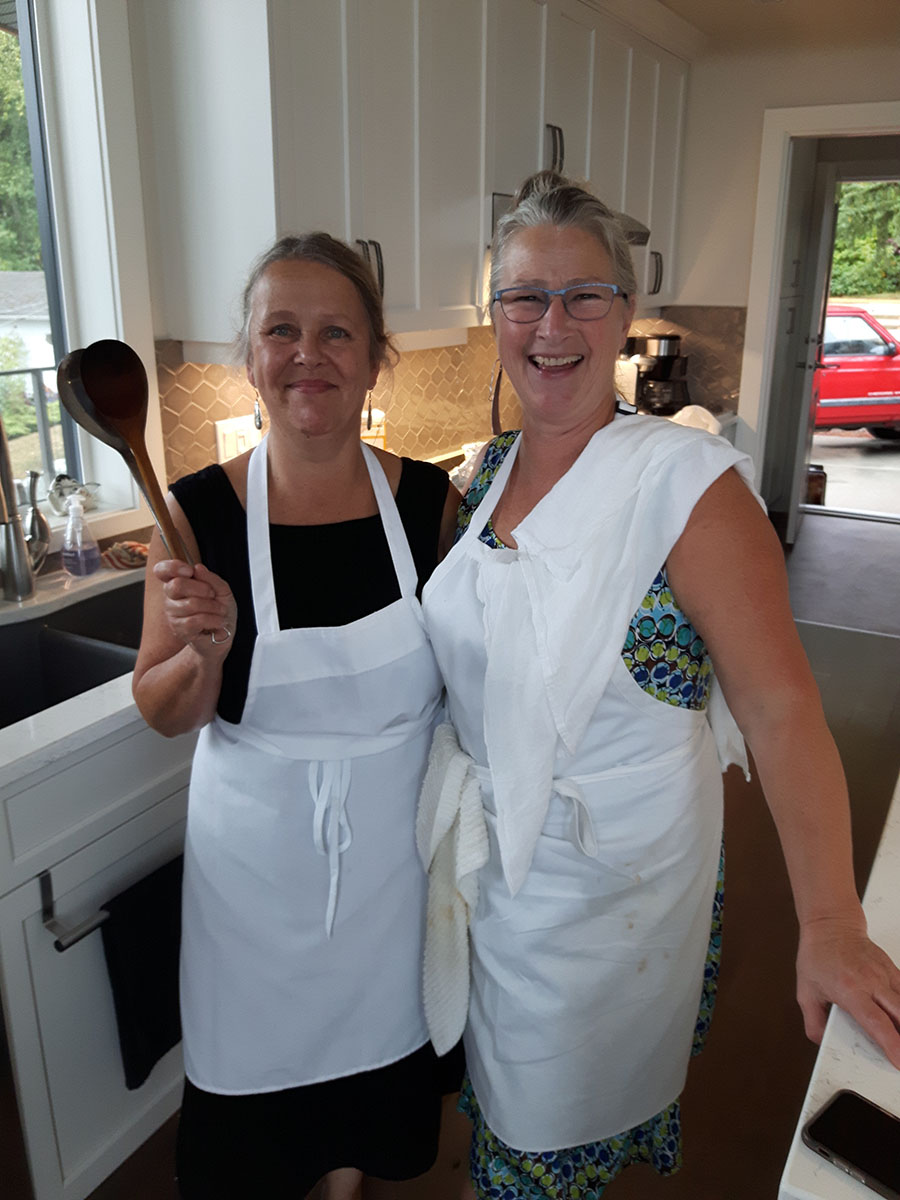 Michelle Plain (right) with kitchen & catering helper Leslie (left).
