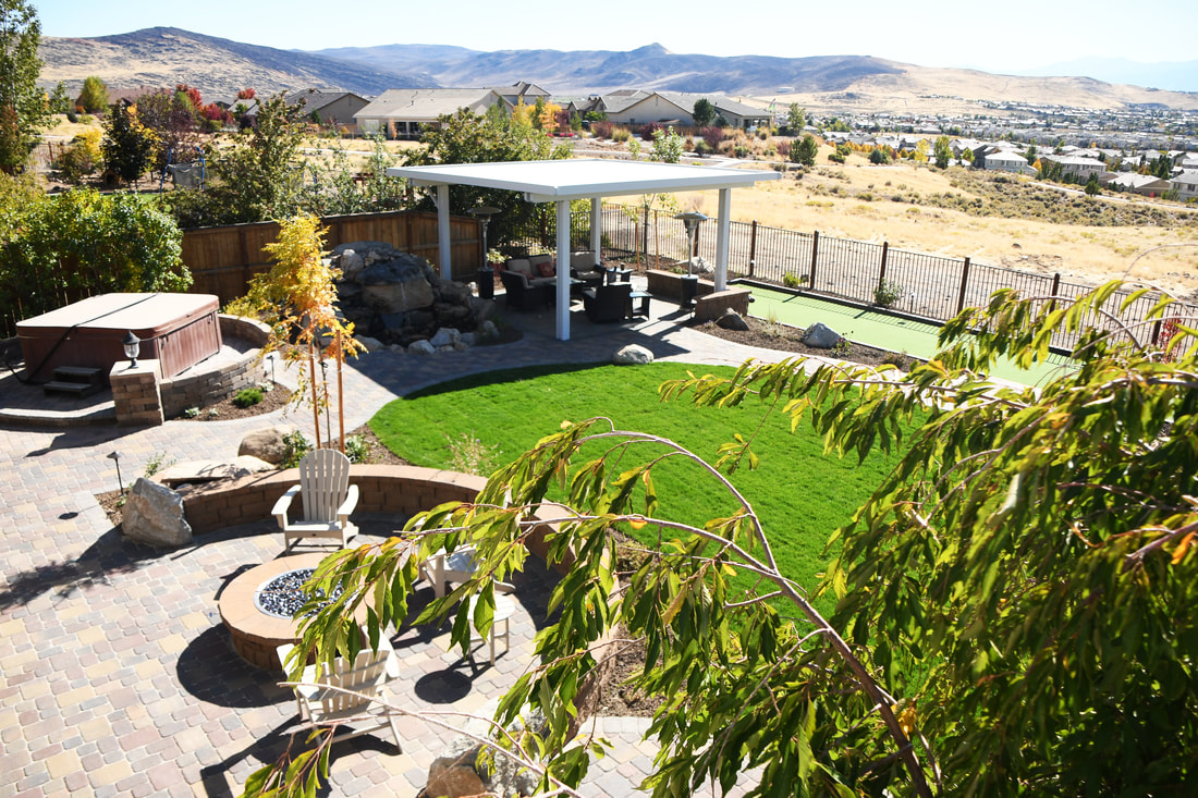 Landscape design for pergola and outdoor fireplace in Reno, NV