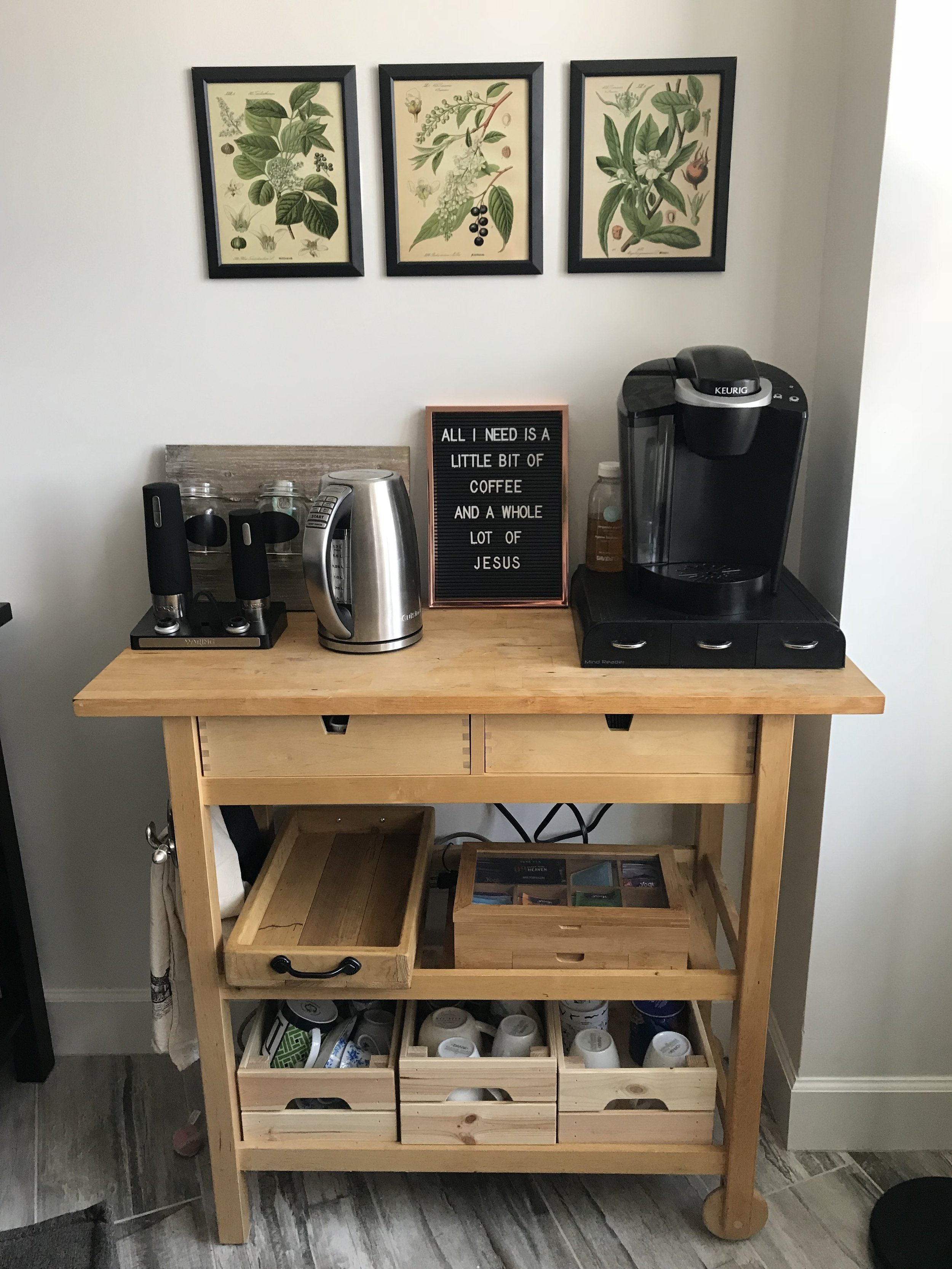 My husband and I love to drink an assortment of teas and coffees. We utilized an  IKEA  kitchen cart to store all of our appliances, mugs, teas, coffees, and condiments.