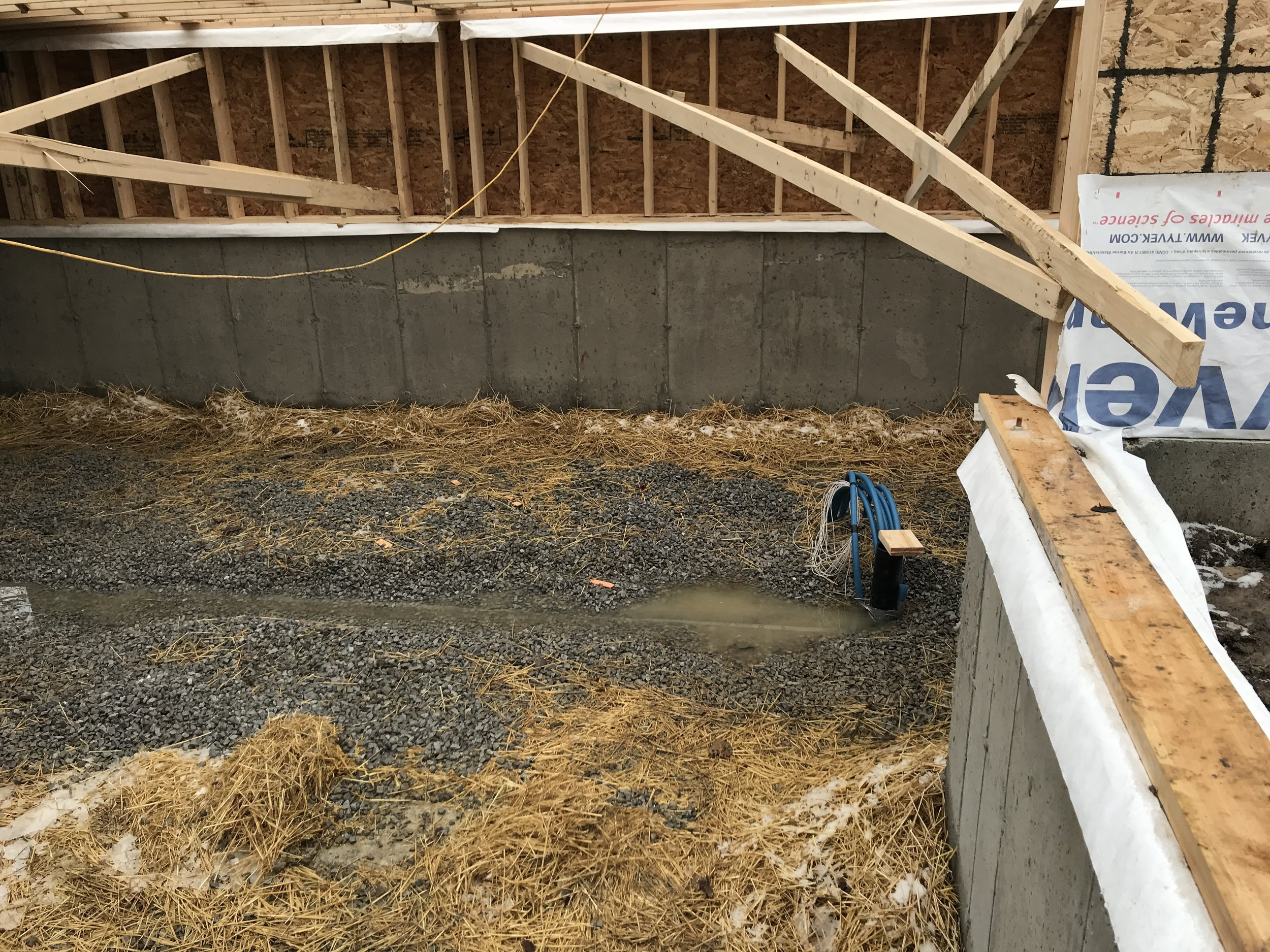 Hay as insulator for the foundation footings