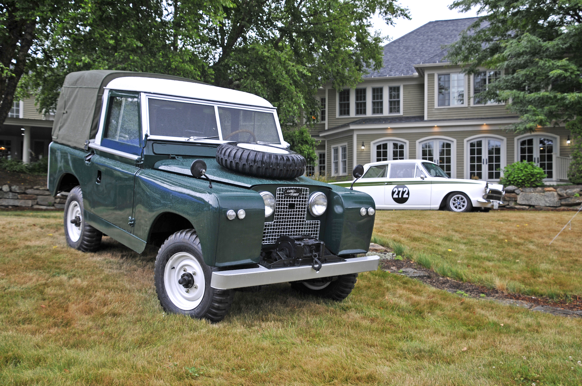 Vintage land rover in front of house.jpg