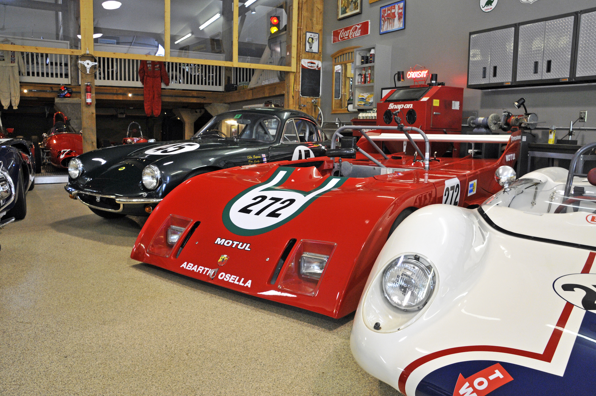 Vintage race cars inside of barn.jpg