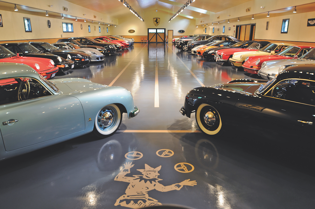 view of classic car barn with cars lining the showroom floor.jpg