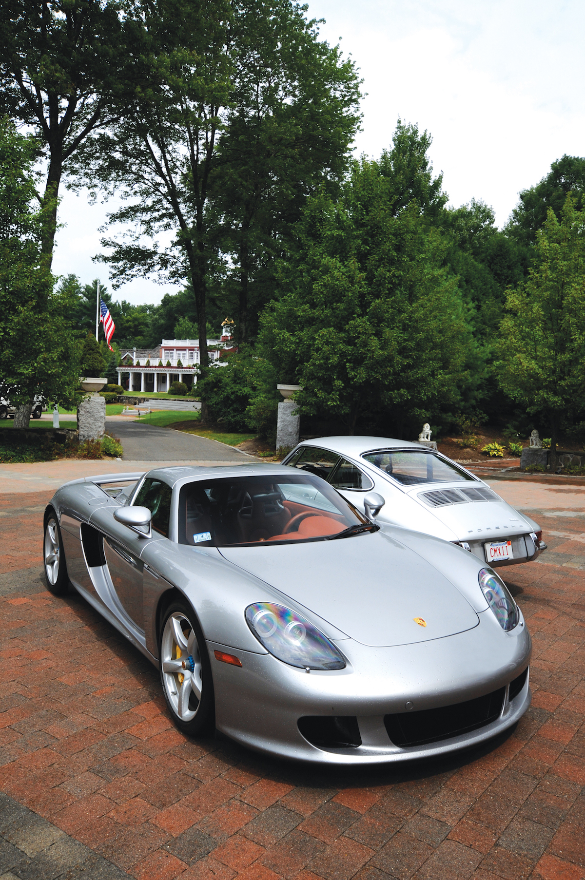 porshes lined up in driveway.jpg