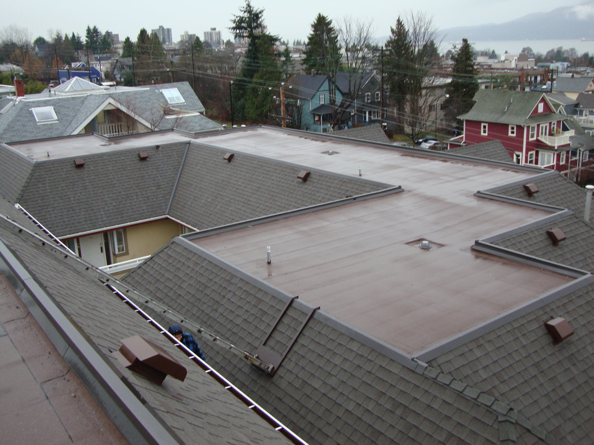 Shingle and Flat Roof Replacement - Broadway Roofing is an industry leader in multi-family/strata sloped and flat roof replacement. We have built our name on quality workmanship and excellent project management from start to finish.