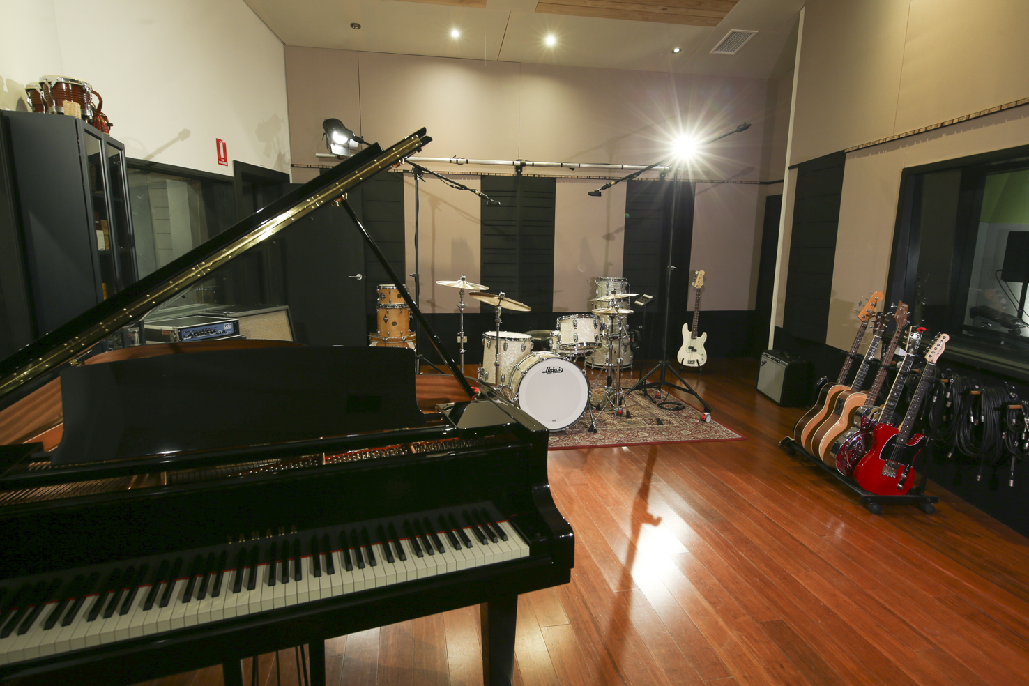 Live Room - Home to our Yamaha C5 Grand piano and an extensive range of other instruments, our main recording room feels and sounds warm but alive. Uninterrupted vision to the booths and control room allows for seamless live band tracking and keeps you connected with everyone as you lay down the perfect take.