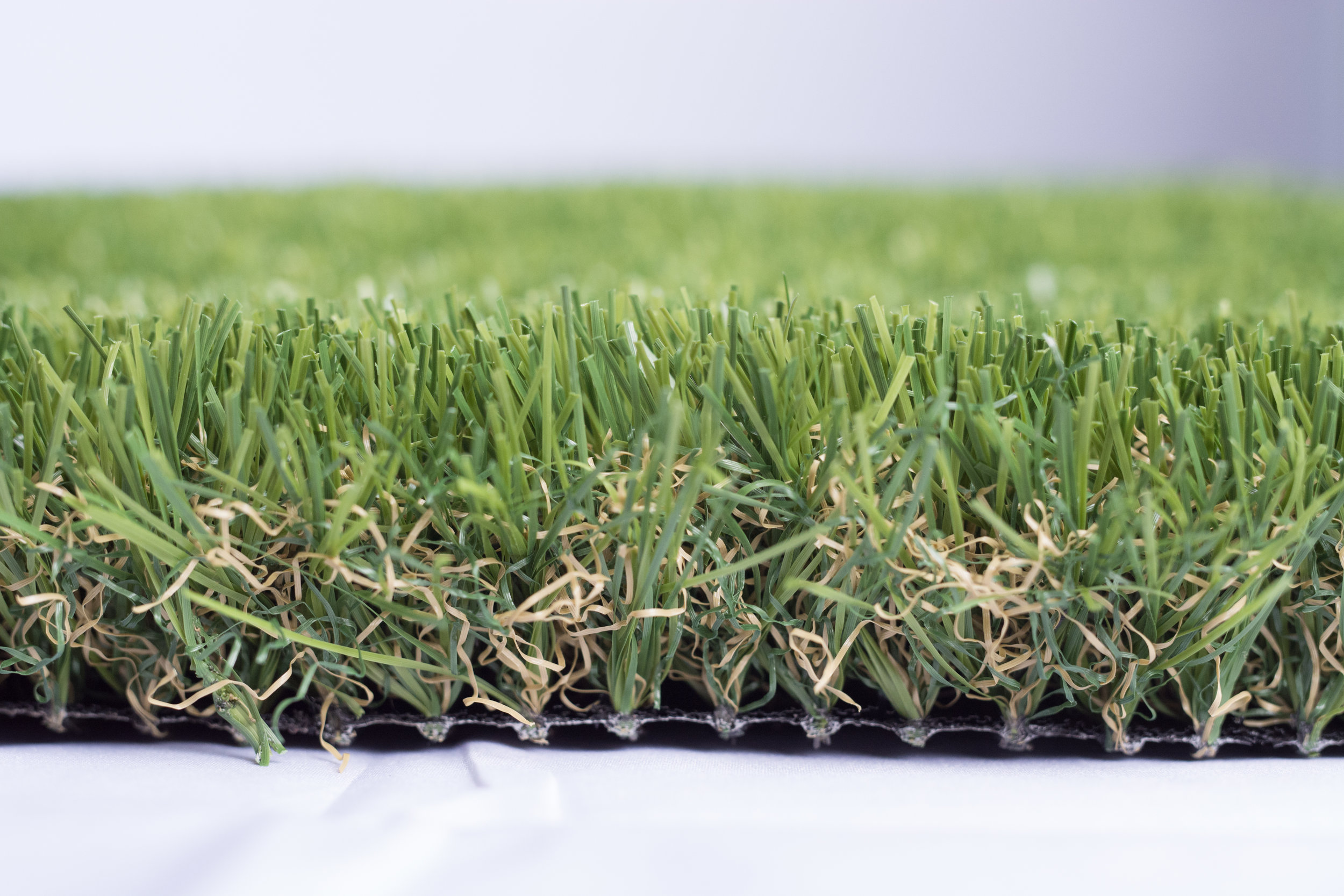 Grand Grass Pro - Grand Grass Pro is our most soft grass. It is popular for back yard play areas.PropertiesFibre colour: Forest & LimeThatch colour: Green & BrownPile height: 1.75