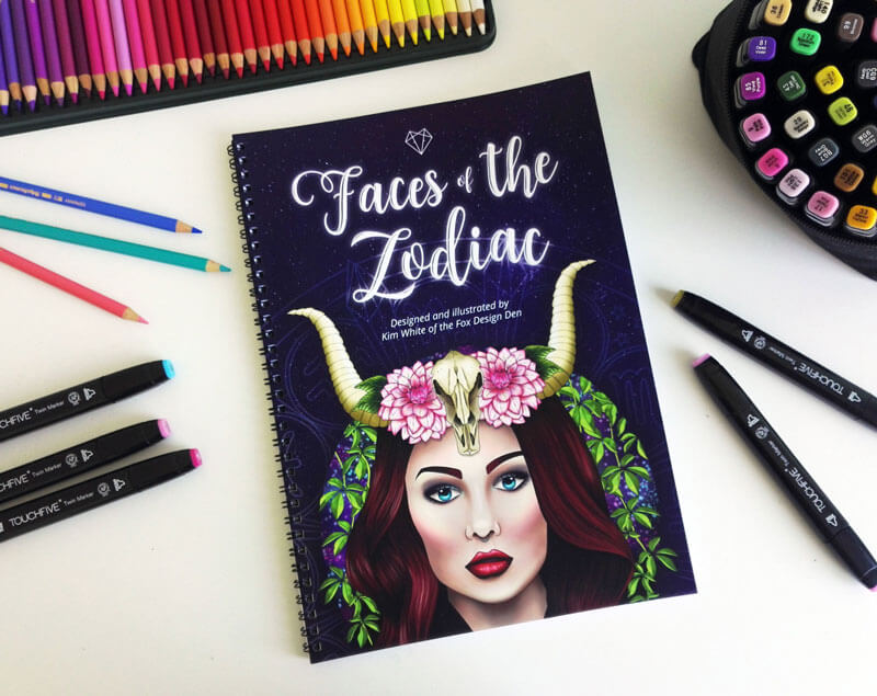 Wire-bound paperback edition of the  Faces of the Zodiac  colouring book