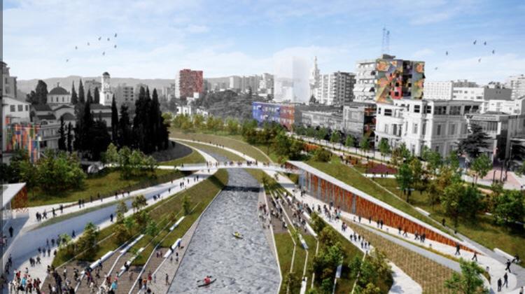 Arkkitehdin suunnitelma joenvarsi puistosta keskeltä kaupunkia.