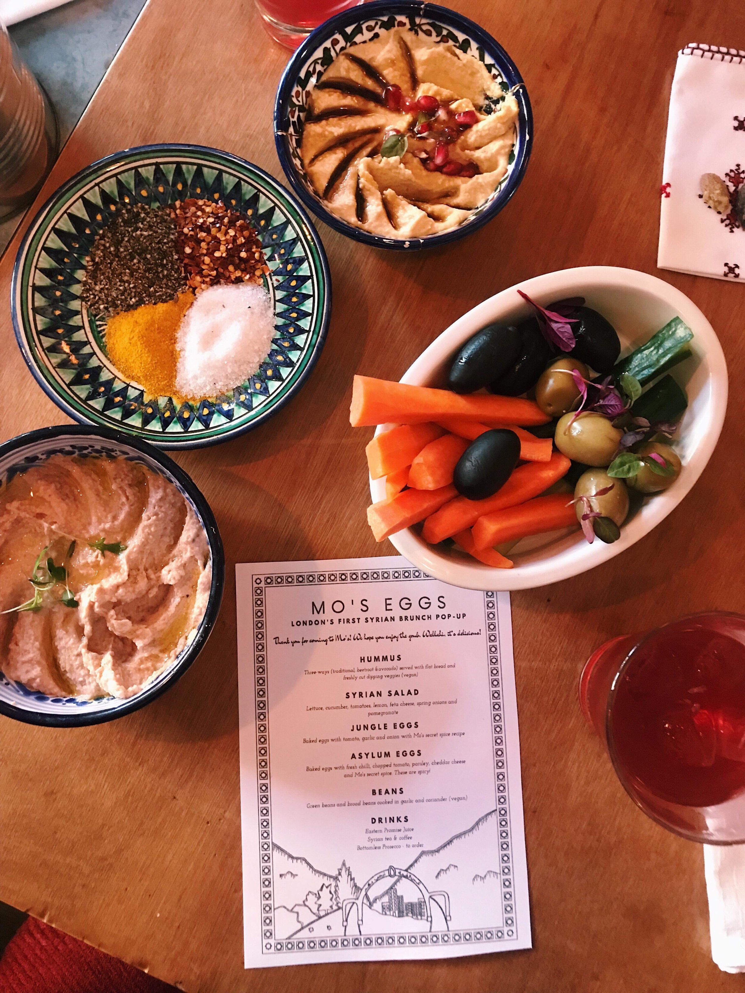 Brunch at Mo's Eggs starts with mezze including three types of hummus. Photo by Susan Davis.