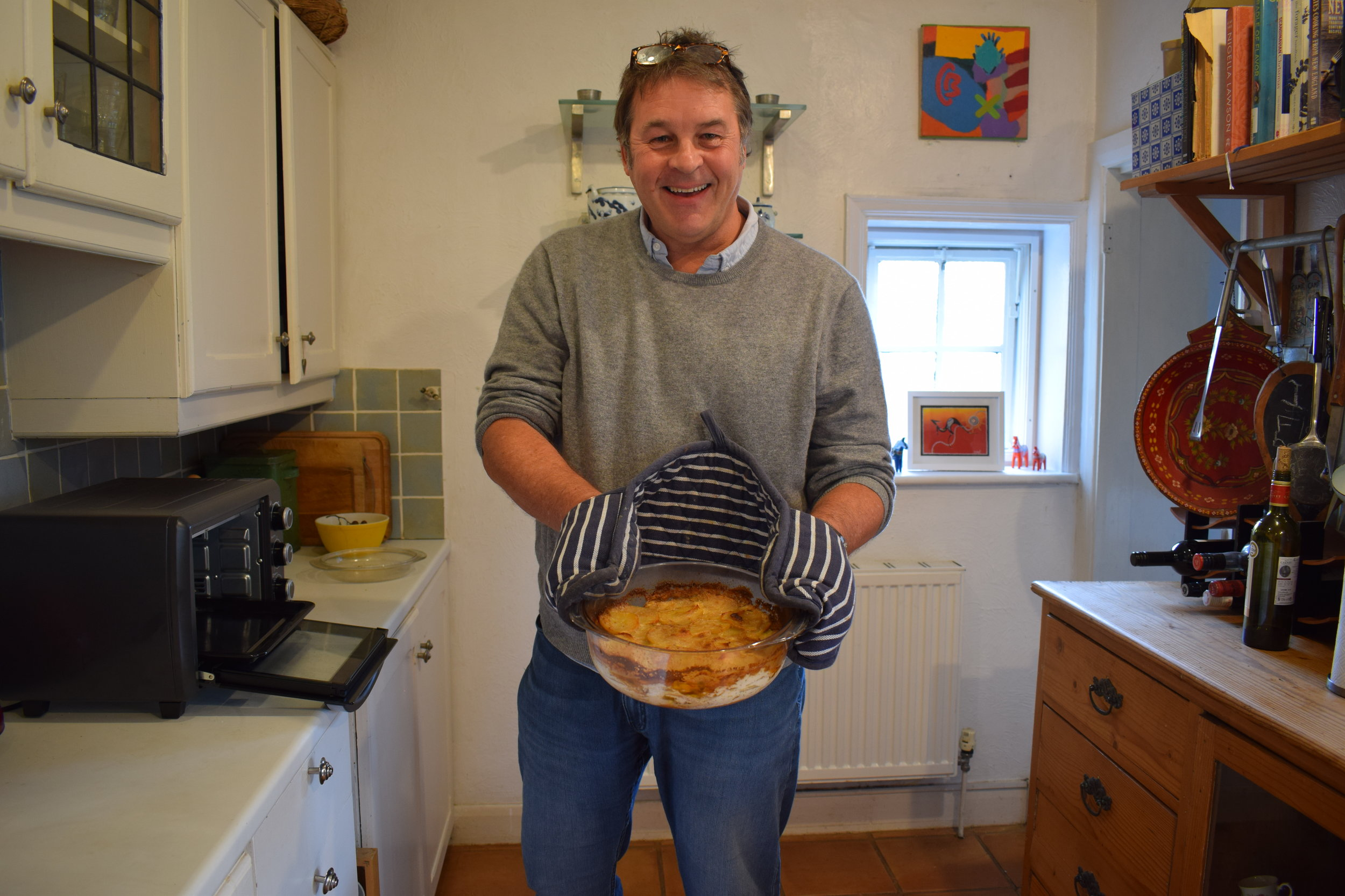 John with the finished dish, just out of the oven. Photography by Bethan Kapur.